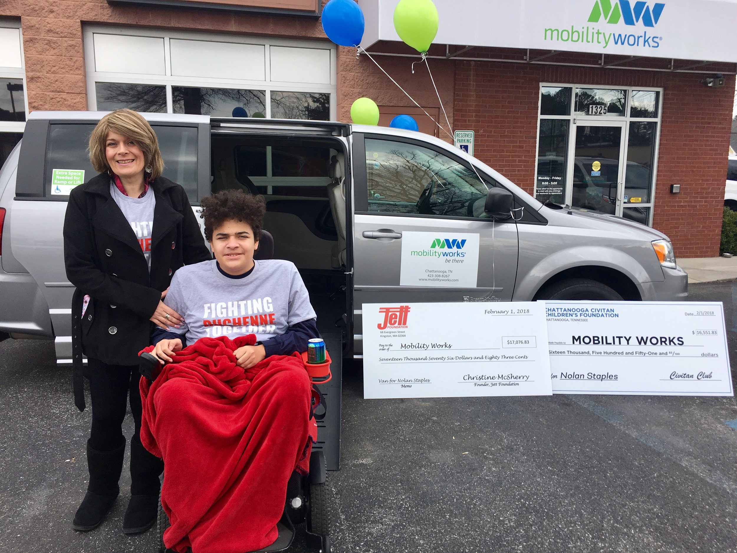 Misty, Nolan, and their new accessible van.