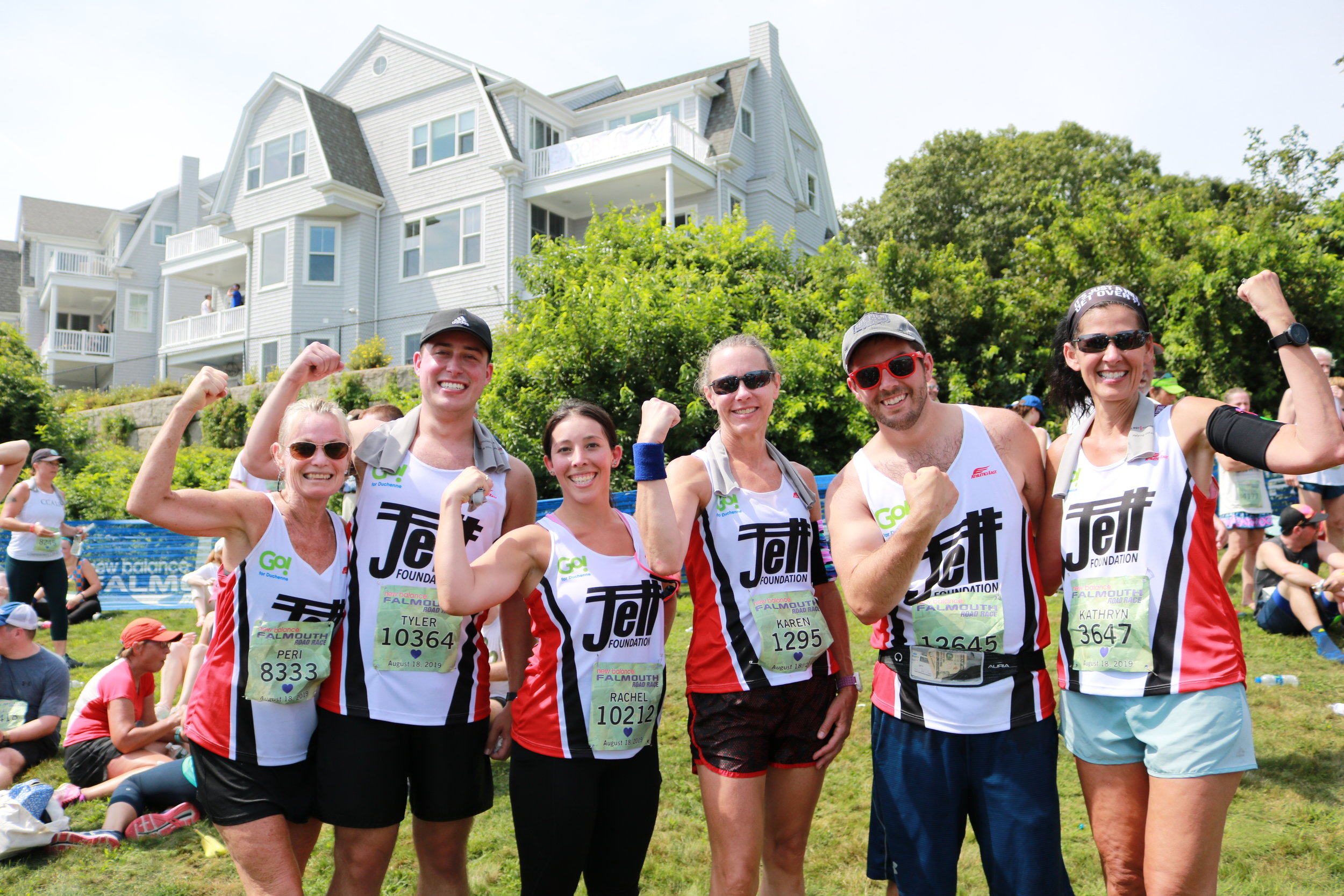 Some of our Go! for Duchenne Falmouth Road Race team members posing after crossing the finish line: (L-R) Peri, Tyler, Rachel, Karen, Brandon, and Kathryn.