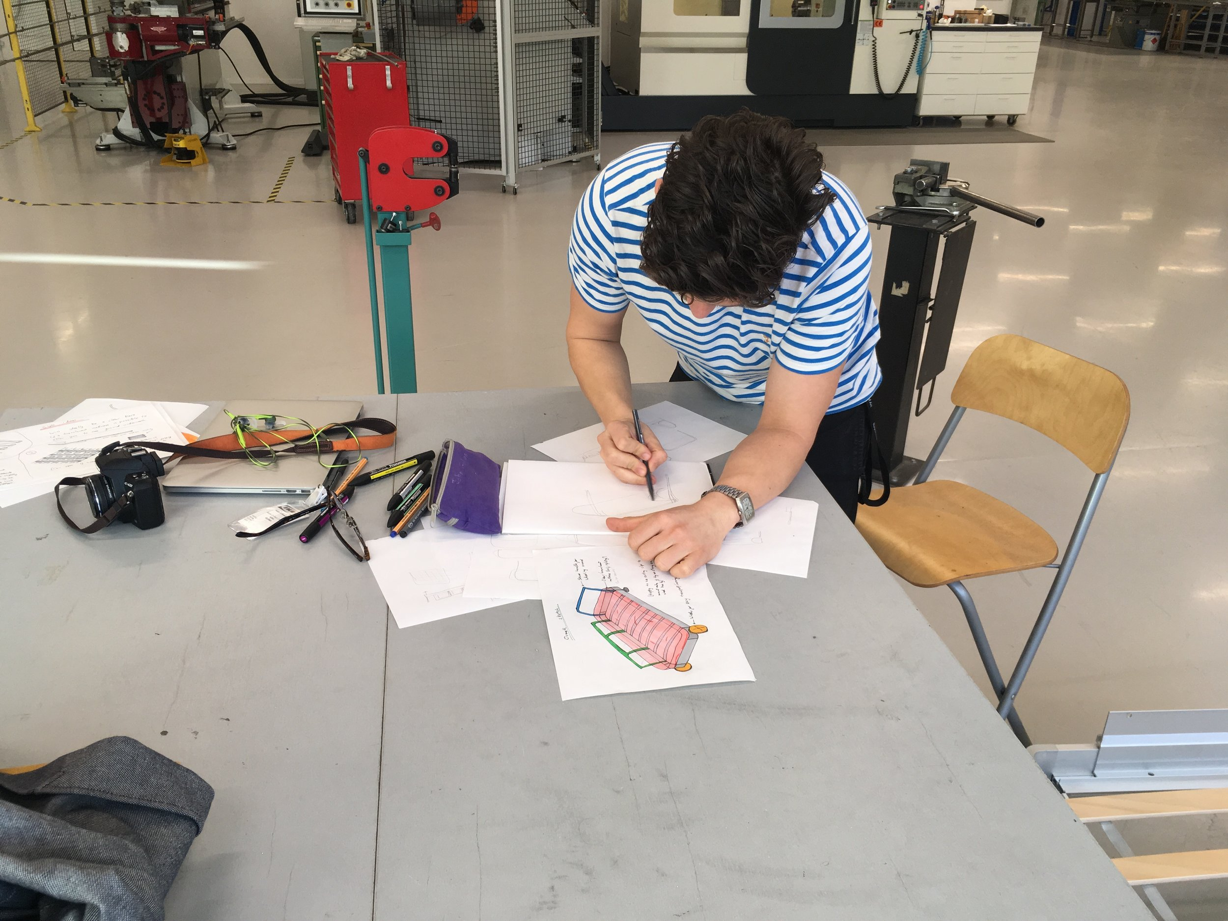 Me sketching in IKEA's metal shop, ready for prototyping
