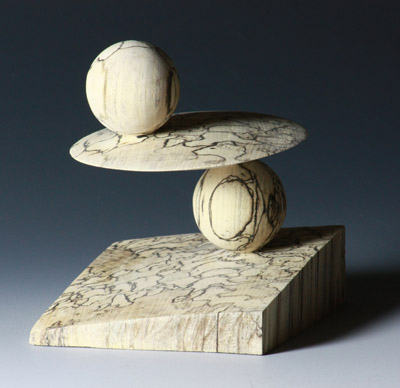 Spalted holly by Barbara Dill. This is a single piece of wood she turned on 2 axes. -