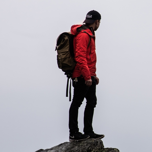 Man standing on a ledge