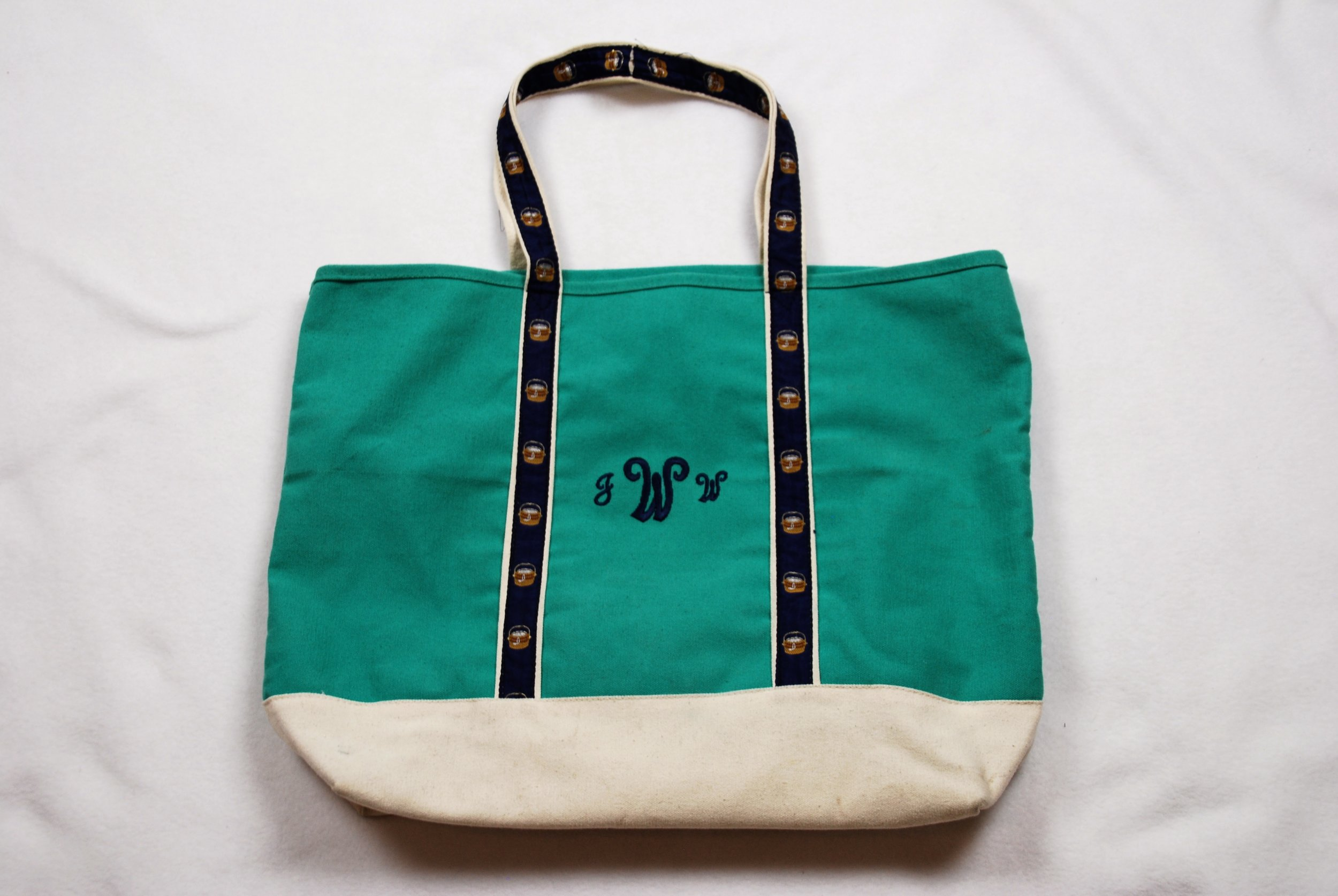 Embroidered monogram on canvas boat bag.
