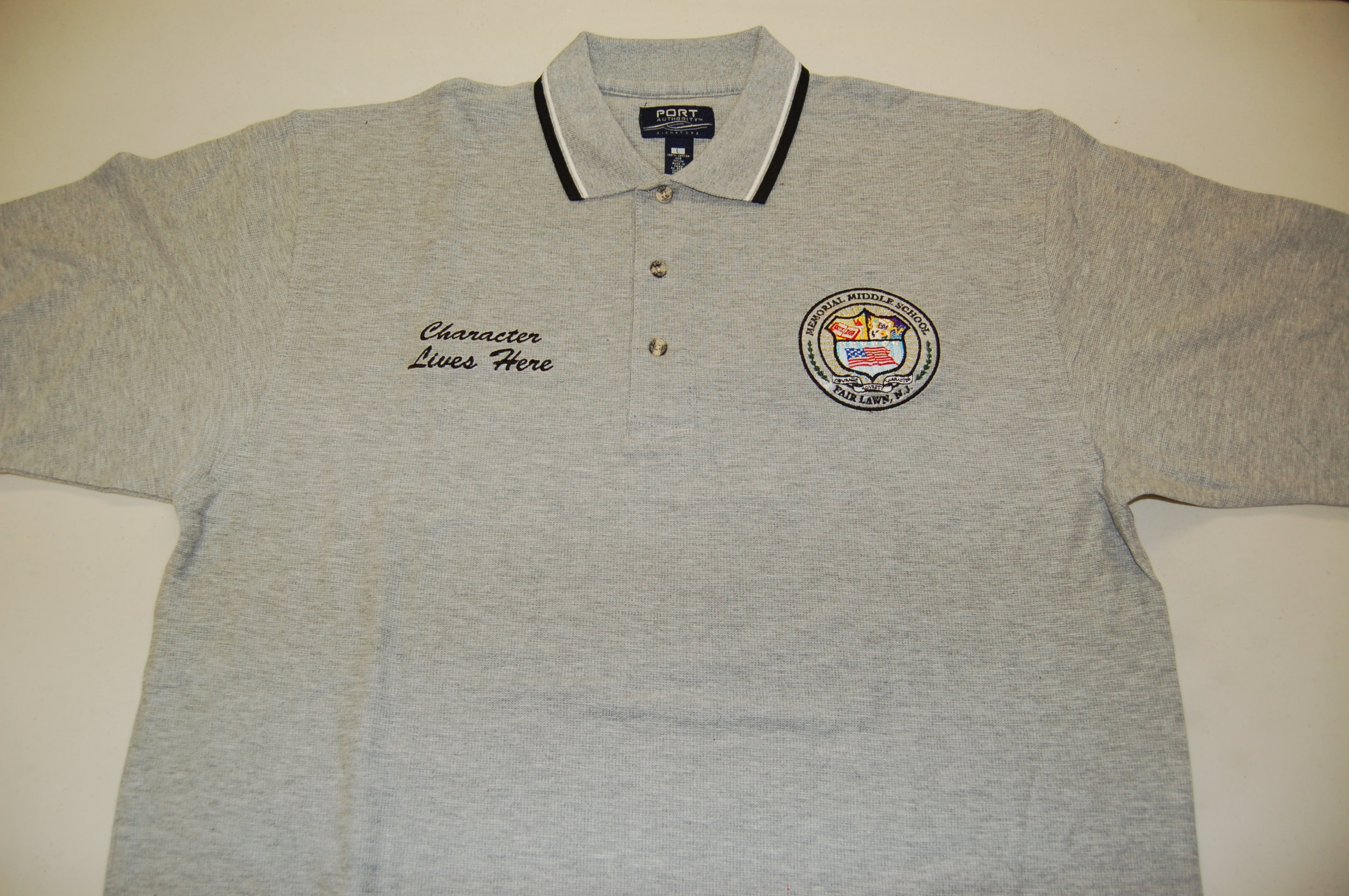 Memorial Middle School embroidered polo shirt.