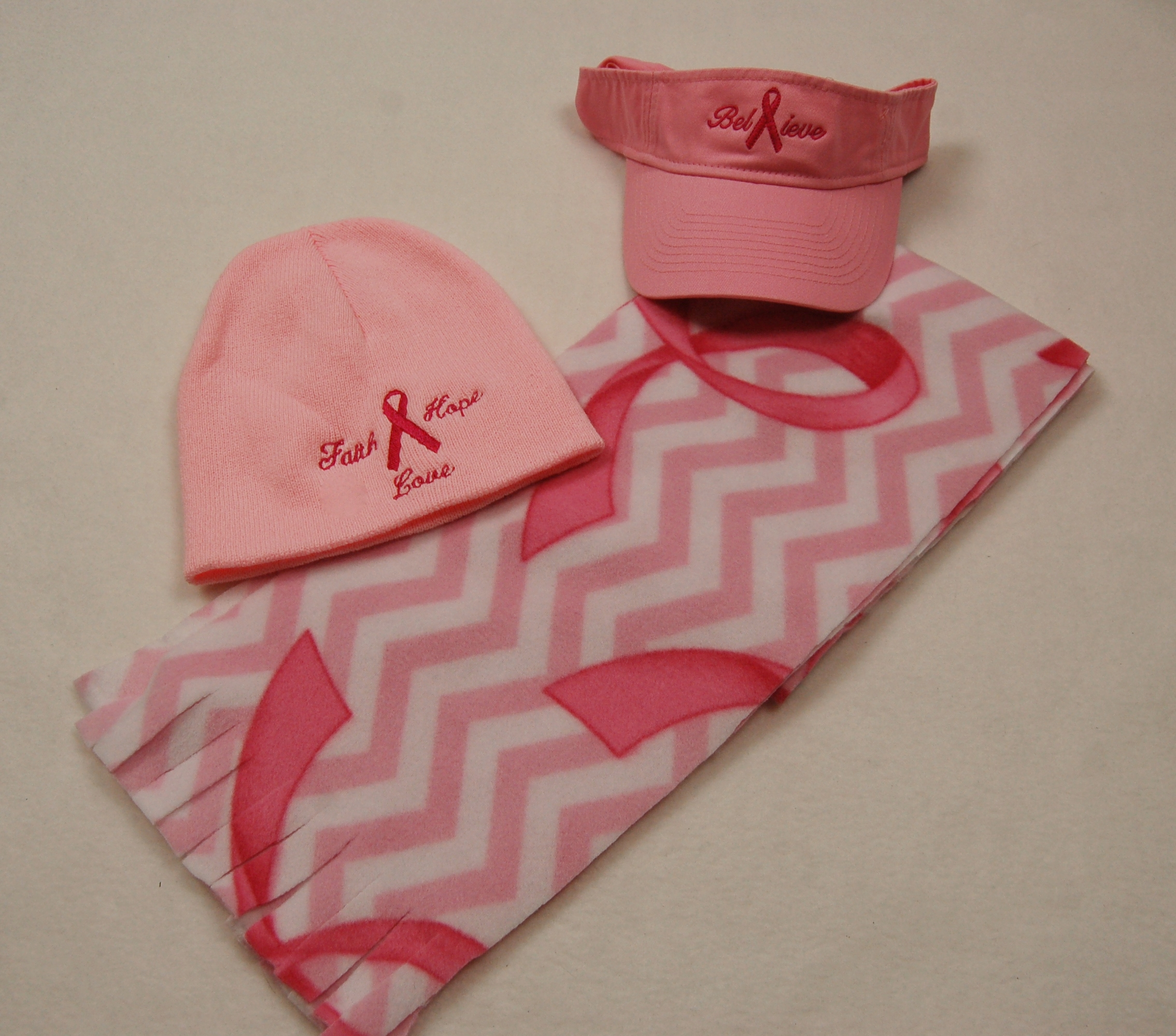 Awareness scarf, visor, and beanie.
