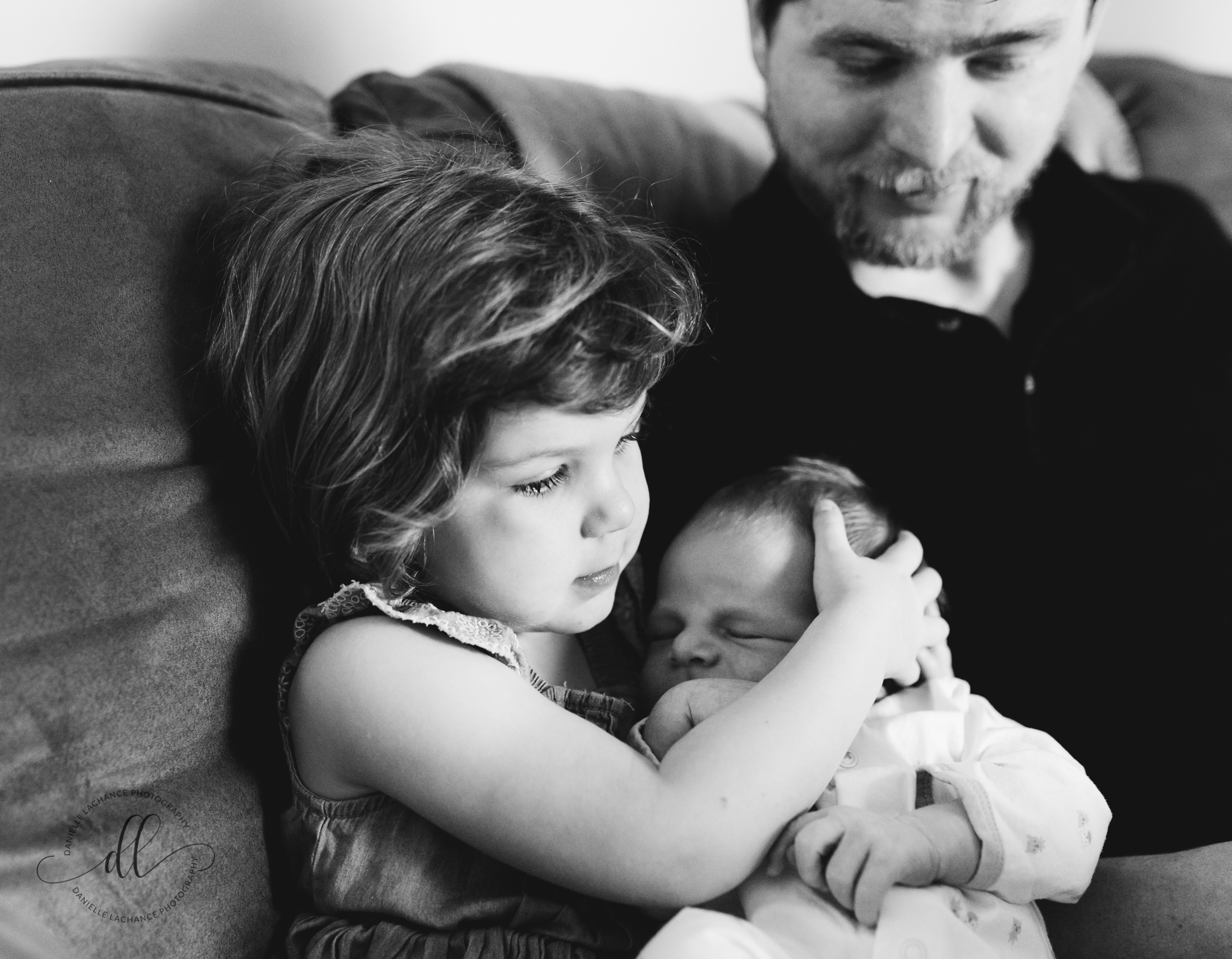 maine-family-newborn-in-home-lifestyle-natural-photographer-siblings-big-sister-holding-baby.jpg