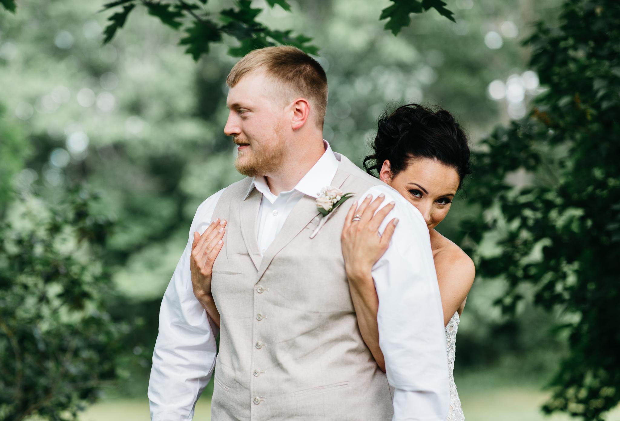 dayton-maine-wedding-photographer-bride-groom-a barn-hitching post.jpg