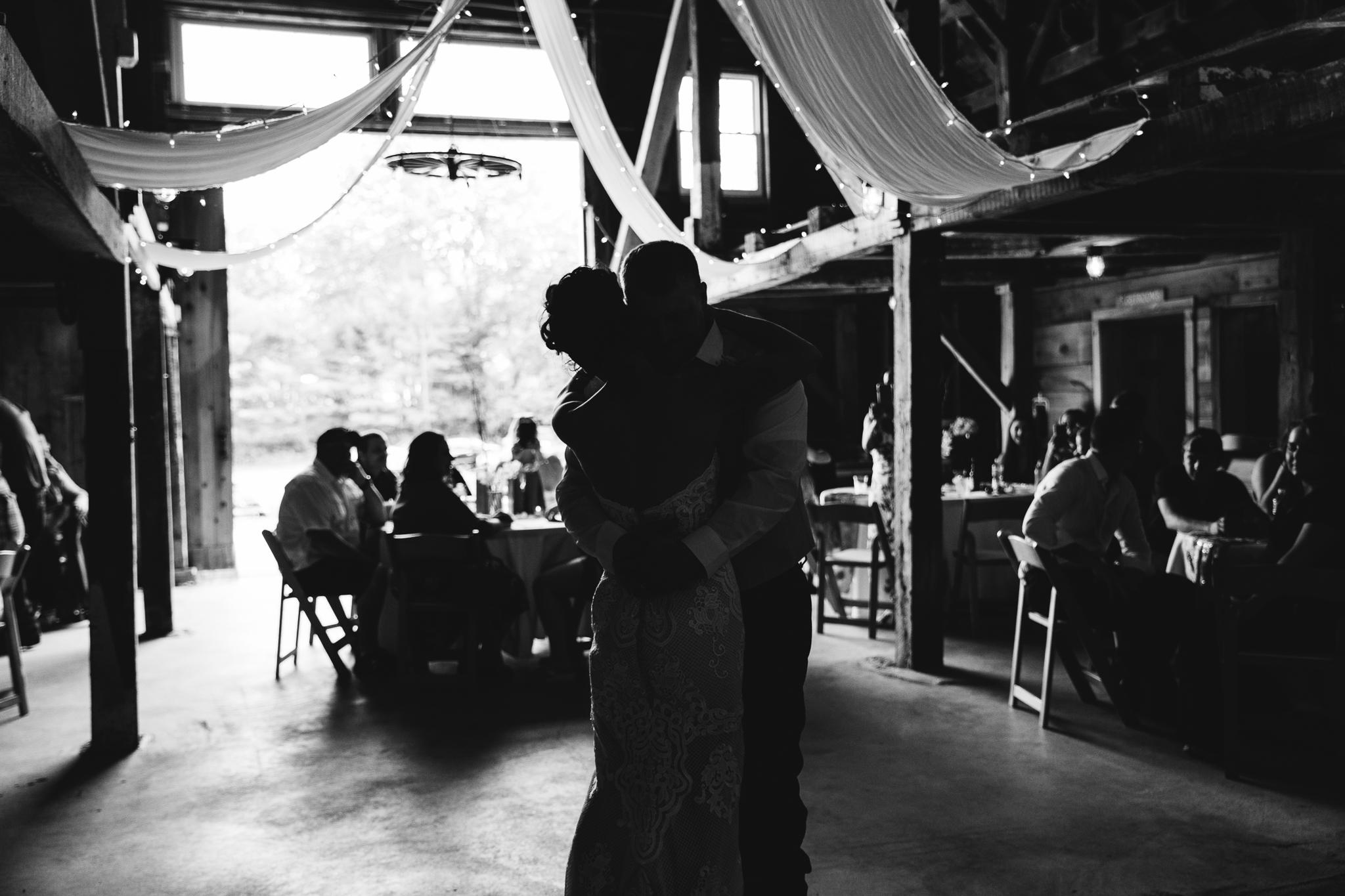 maine-wedding-first-dance-husband-wife-bride-groom-barn-black-and-white.jpg