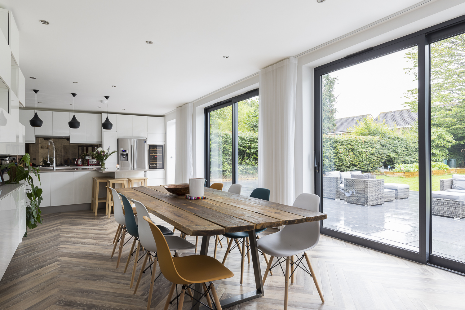 Whole House Renovation, Cheam - The aim of the design for the ground floor was to create a large open-plan kitchen, dining and family space that leads out onto the rear garden. We designed a single storey infill extension and reconfigured the internal walls in order to achieve the open plan space.