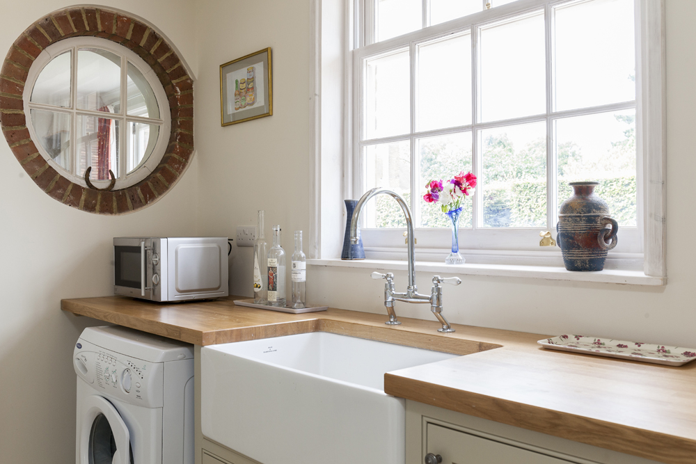 Features and quirky details - As you can see in this example leaving the existing circle external window adds a quirky detail to the design, alongside the butler sink and period sash windows.