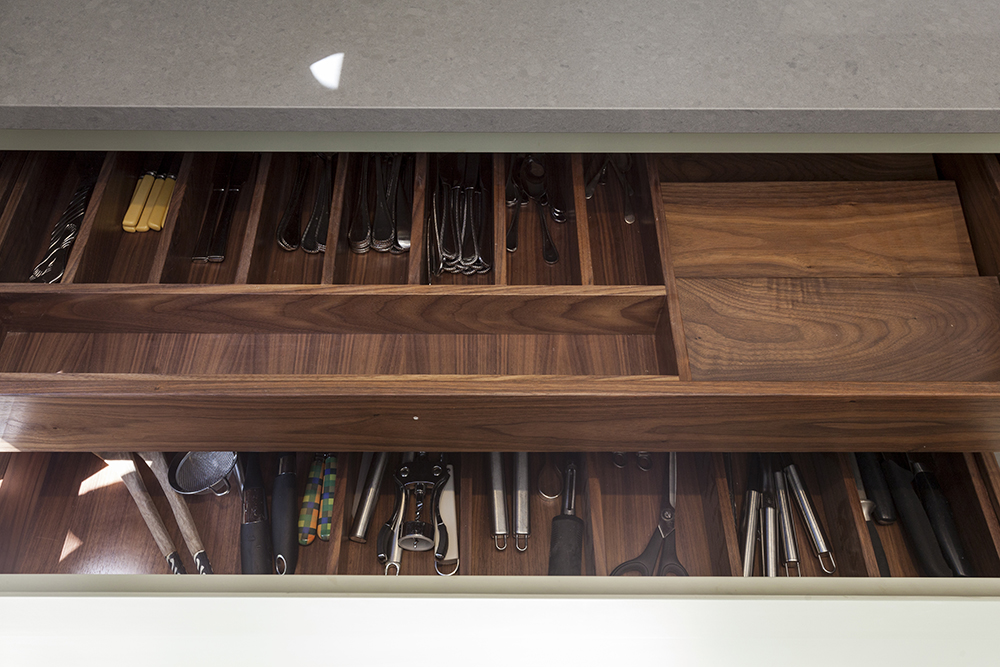 Touch of Detail - The final touches of details can really enhance any kitchen, from the use of handles to the internal finishes of cupboards and drawers. In this example they have used dark timber to create the drawers and spacers. This adds a new element to the simple shaker kitchen.