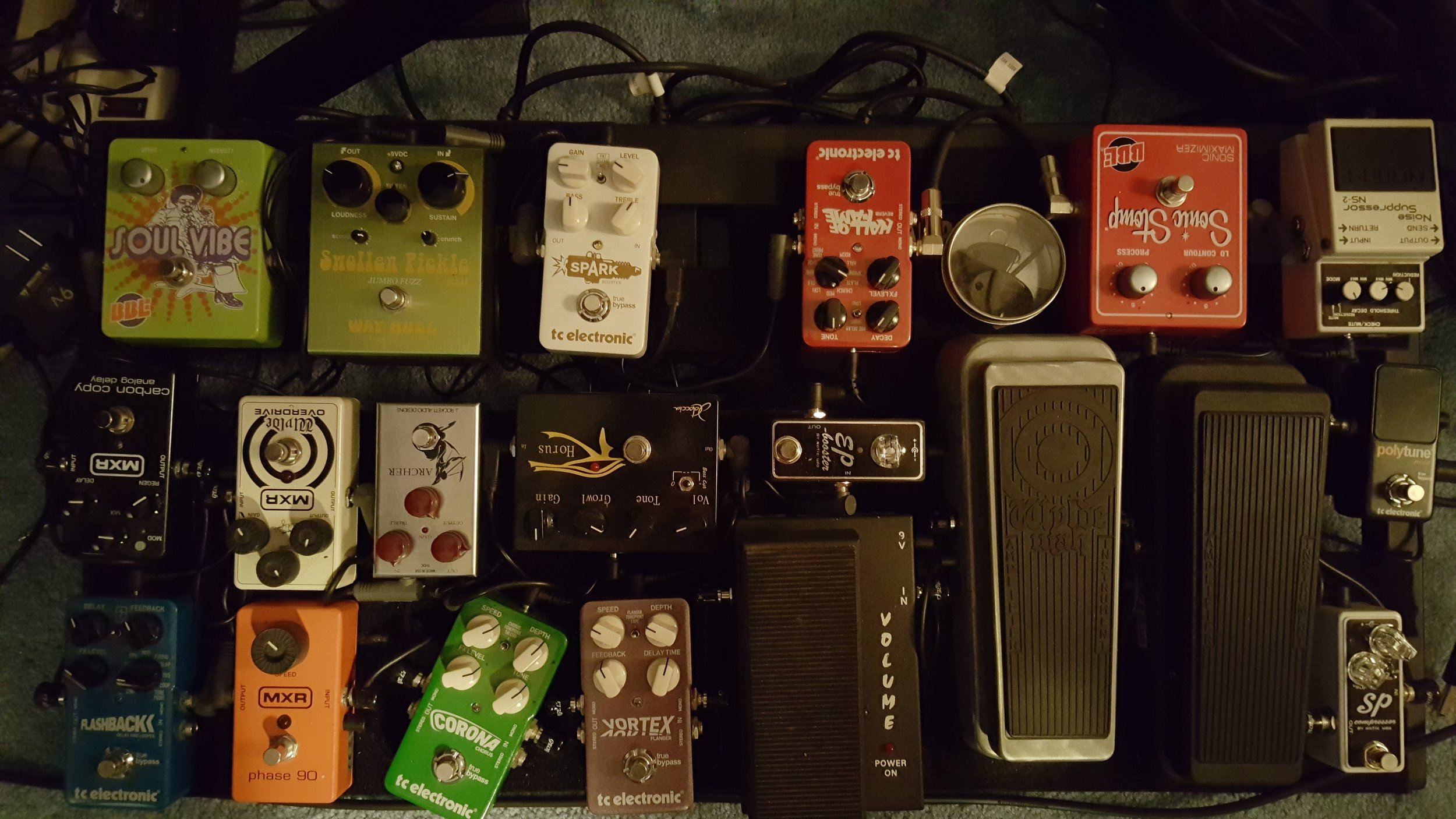 """This is my """"current"""" main pedal board as of May 2017 that I use live and in the studio. Here is what I have on the board:   MXR/Dunlop: Phase 90, Zakk Wylde Overdrive, Carbon Copy Delay, Original Spec Wah, & a Zakk Wylde Wah.   TC Electronics: Flashback Delay, Vortex Flanger, Carona Chorus, Polly Micro Tuner, & Sparks Booster.   Boss:  Noise Gate.   BBE:  Sonic Stomp Enhancer, & Soul Vibe roto-vibe pedal.   Way Huge:  Swollen Pickle Fuzz.   Morley:  Mini Volume Pedal.   Exotic Effects:  SP Compressor & EP Booster.   J Rockett Audio:  Archer Overdrive.  I never used to use guitar effects pedals but have since grown to love them. I don't use a lot at one given time but these give me options for different sounds which work out great depending on what song I am playing. I also have an extension pedal board which has two line 6 pedals. I don't use this board a lot but would like to expand on it and start using it live. I also have a smaller acoustic pedal board for instrumental pieces."""