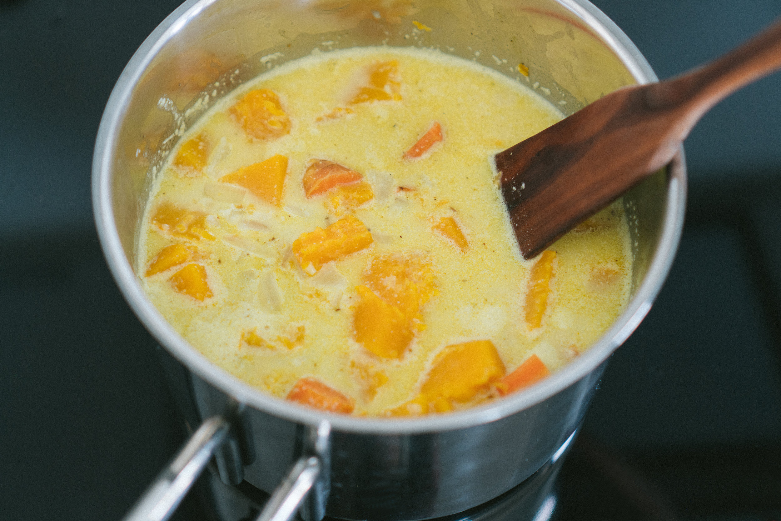 Pour in coconut milk, stock or water and fish sauce if using. Let it simmer for 10 minutes.