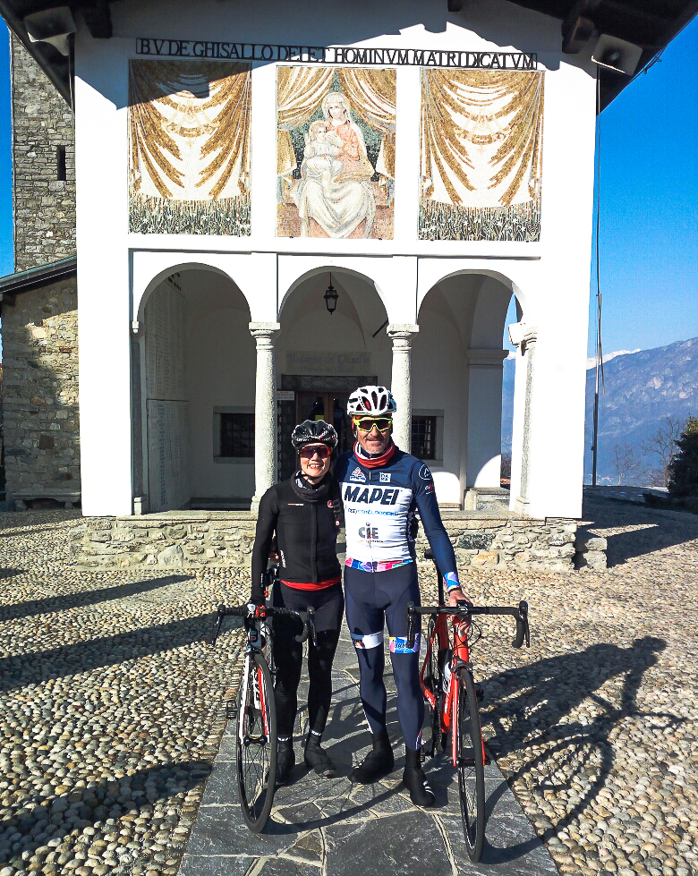 ComoLagoBike Cycling Manager, Alberto Elli, guiding a guest to the Madonna del Ghisallo chapel.