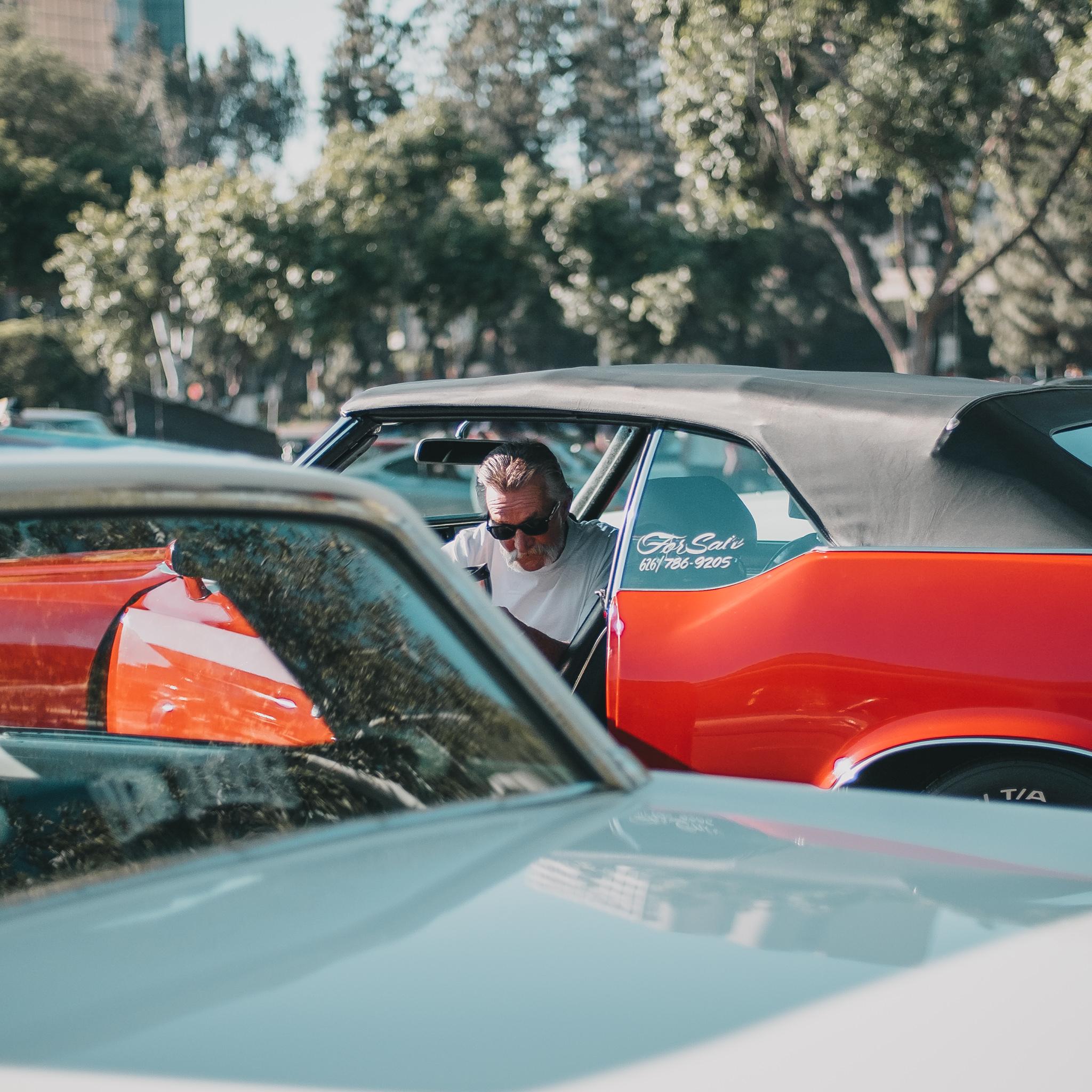 man exciting red car.jpg