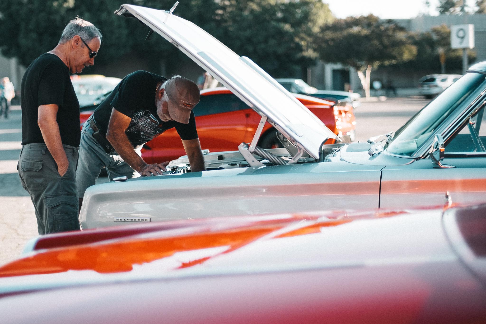 two men open car hood.jpg