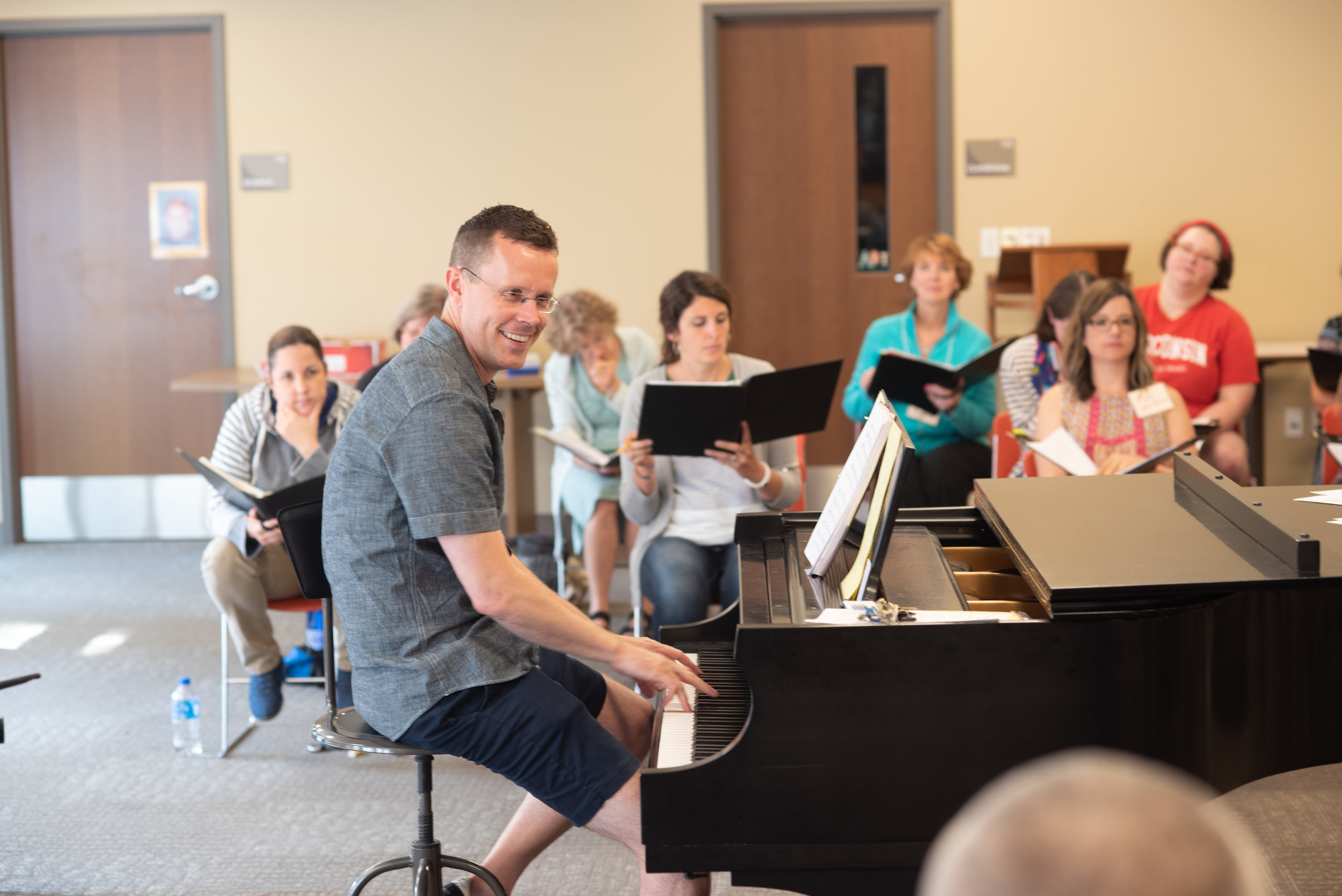 Mike McGaghie rehearses the group in 2018