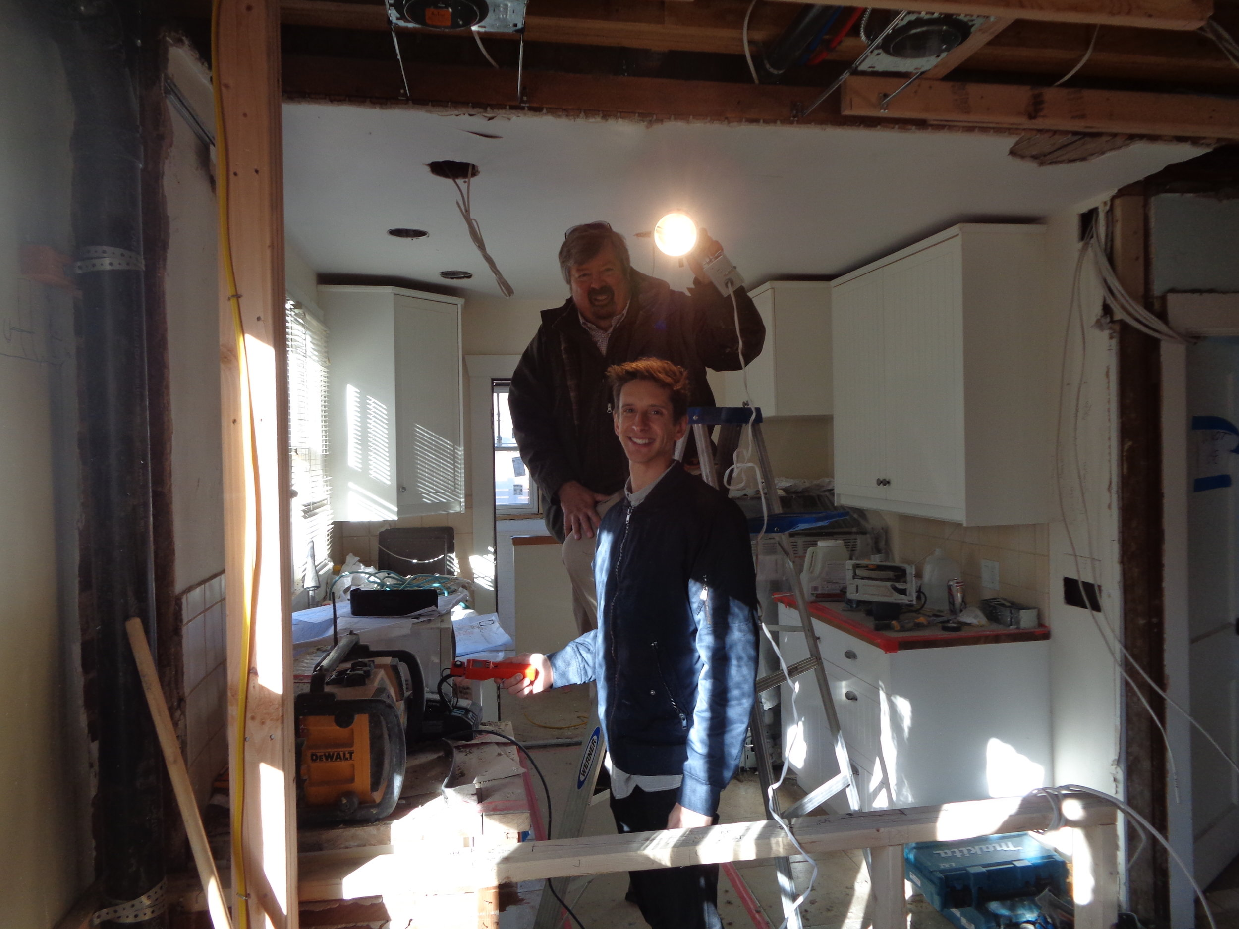 Client Mike Flaherty and I show how we measured four different lamp types at five different locations overhead in his remodeled Congress Park kitchen the night before (you need dark!)