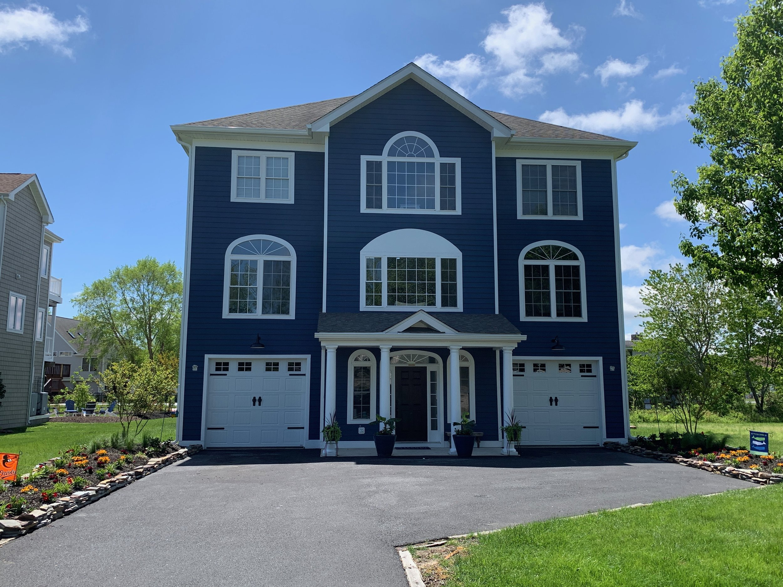 """""""Randy, thank you so much for adding the finishing touch to our dream home in Fenwick! Your team was professional, your pricing was more than fair, and they look absolutely incredible! Thank you for going out of your way to get the hardware we really wanted. We highly recommend Expert Overhead Doors!""""  -Steve and Kelli Wilkenson"""