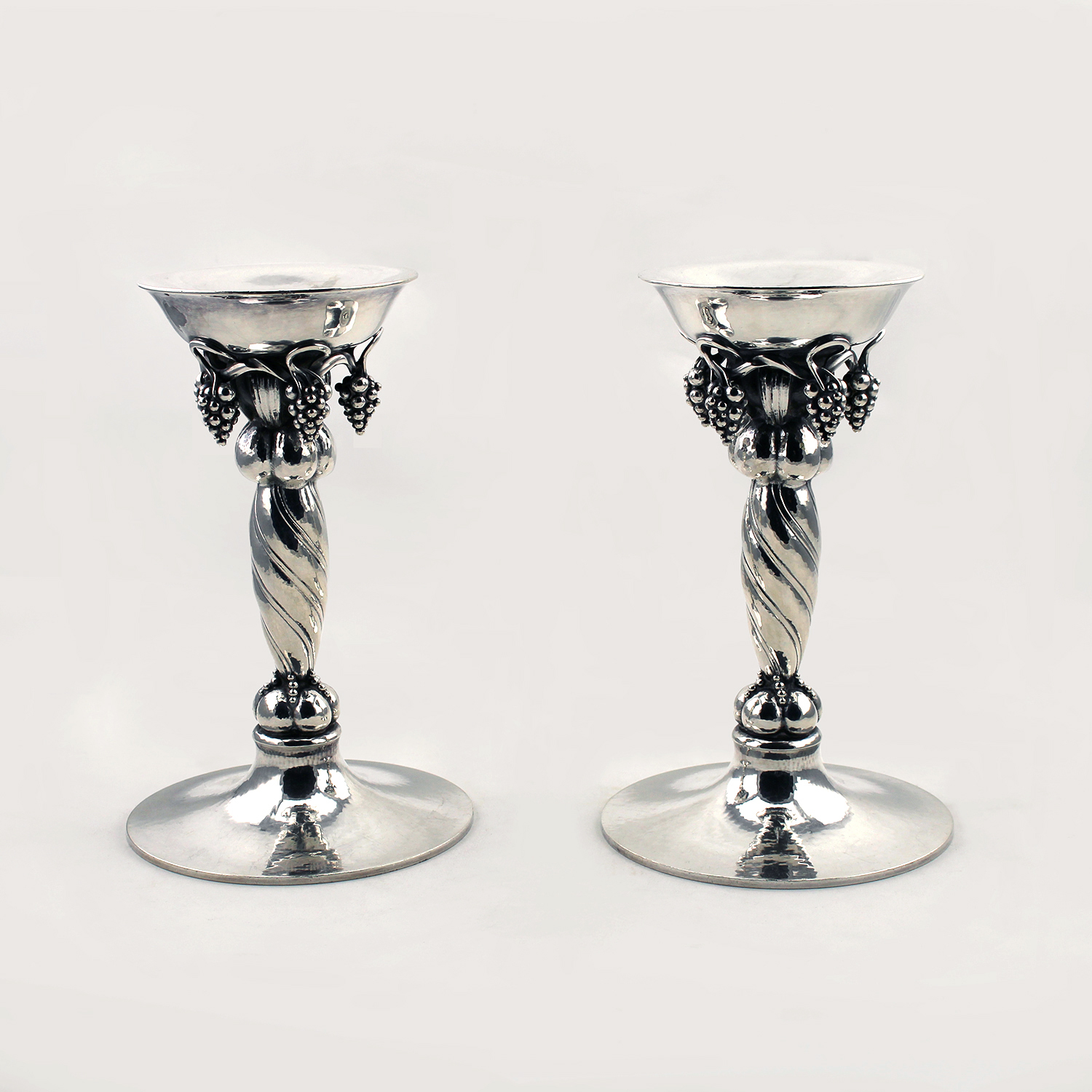 Georg Jensen Pair Of Grape Pattern Sterling Silver Candlesticks