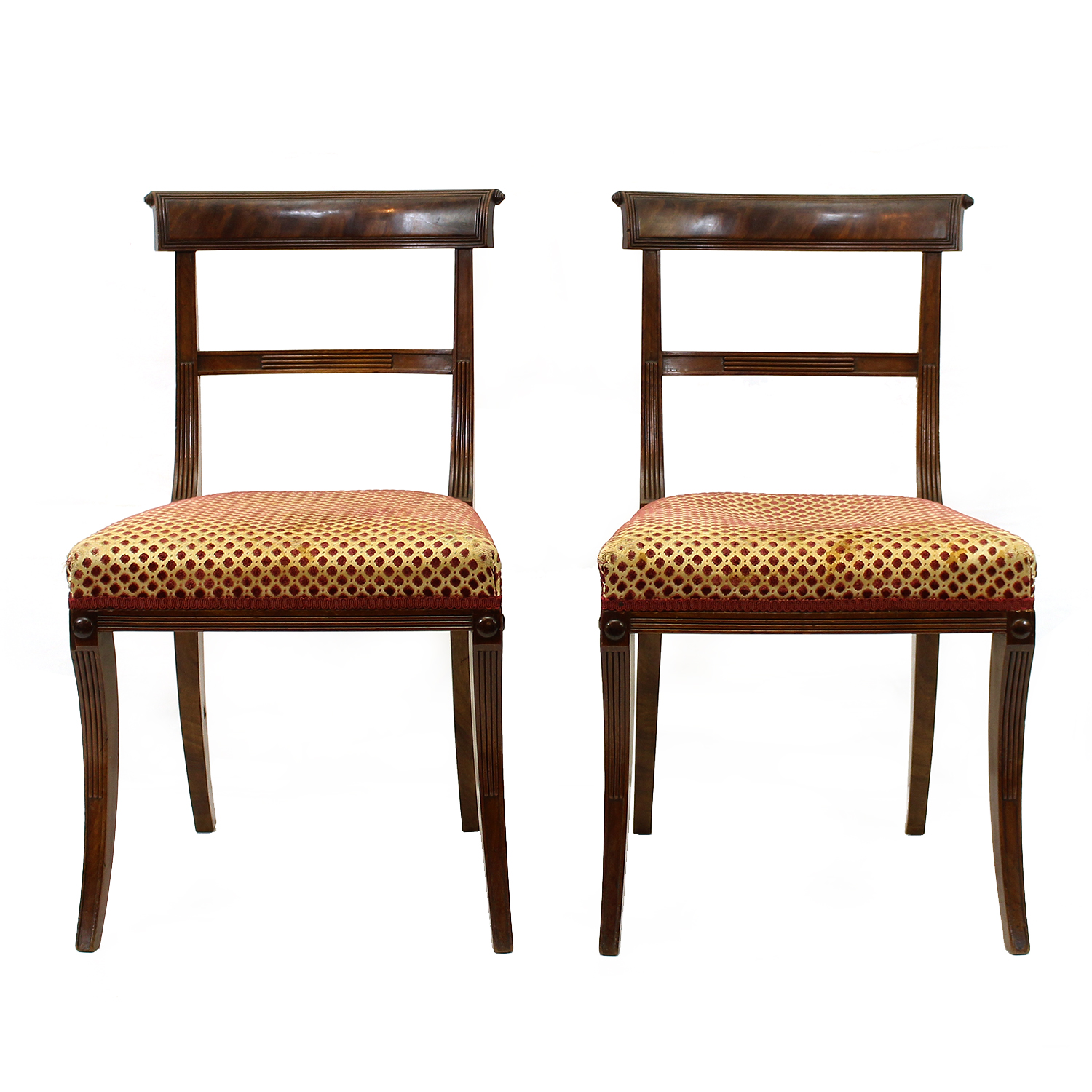 Pair of mahogany Regency side chairs with upholstered seats and sabre legs, English, circa 1840
