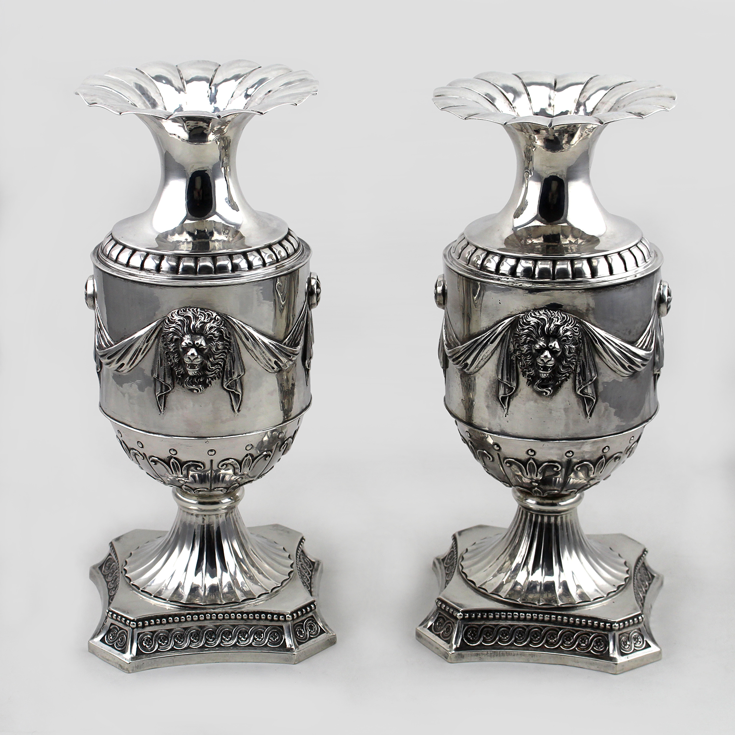 Pair of silver urns, with French marks and English import marks for London 1900