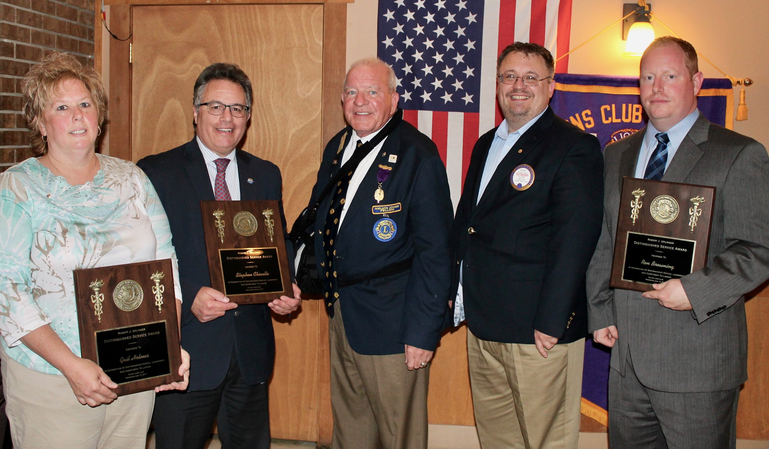 "Three Fulton Lions received the Robert J. Uplinger Distinguished Service Award. Established in 1993, the Uplinger award honors outstanding Lions, non-Lions and organizations that perform exemplary service to the club, district or community, said outgoing president David Guyer. ""Recipients Ron Browning, Gail Holmes and Steve Chirello have demonstrated the highest examples of Lionistic character, ideals, purpose and service. From left: Holmes, Chirello, Lion Douglas G. Russell of Liverpool, past district governor, zone 20-Y1; Guyer and Browning."
