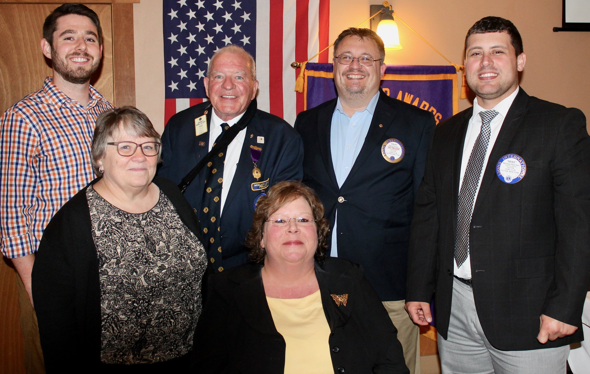 The Fulton Lions Club installed its new slate of officers for 2017-18 and presented club awards for the 2016-17-club year at their June 15 meeting. Michelle Stanard, seated, is president and from left, standing: Zachary Merry, vice president; Linda Hughes, secretary; Lion Douglas G. Russell of Liverpool, past district governor, zone 20-Y1, who presided over the installation; David Guyer, immediate past president; and Michael Reardon, treasurer.