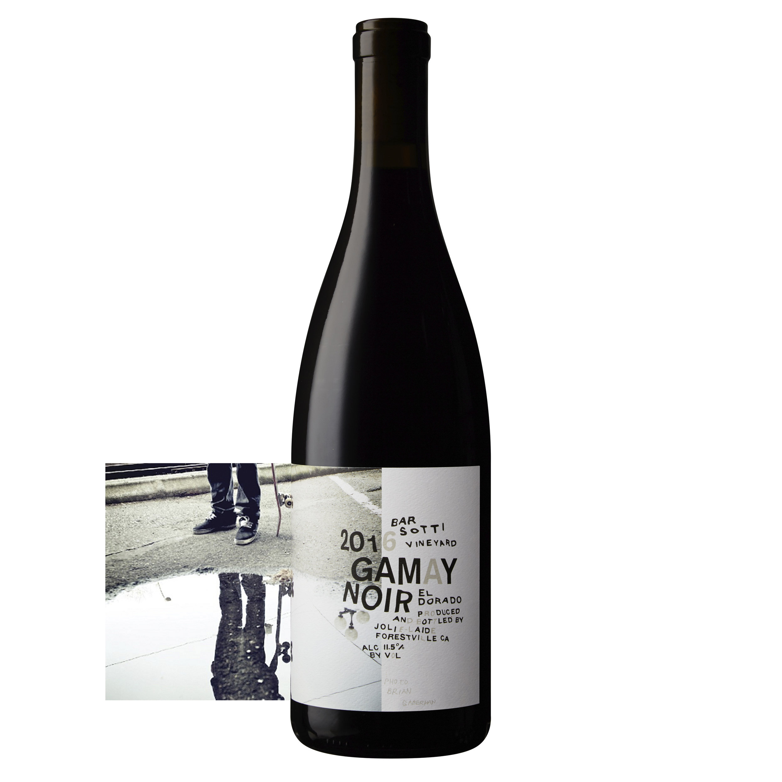 Wrap around label bottle shot photography by Sonoma Bottle. Jolie-Ladie's limited release 2016 Gamay Noir featuring artwork by Brian Gaberman.