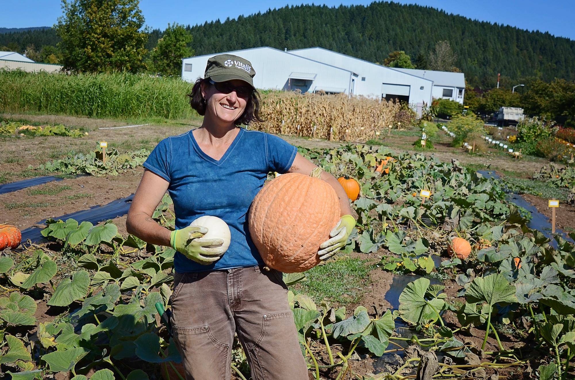 Andrea-evaluating-pumpkins-9-23-15.jpg