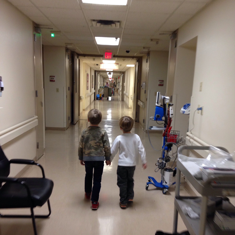 the boys walking through the hospital