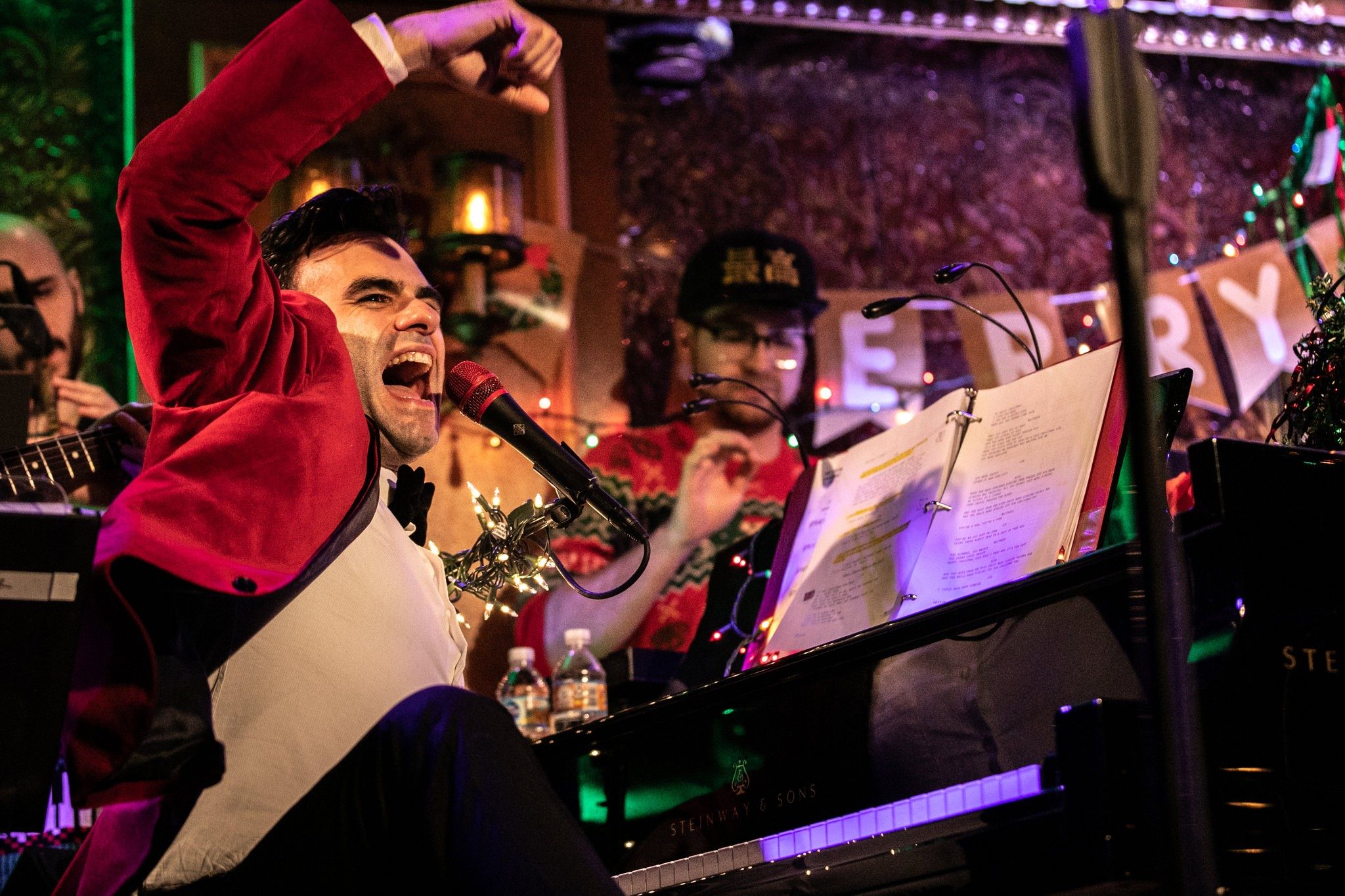 Joe Iconis at his annual Christmas show at Feinstein's/54 Below, which brings together his regular collaborators, many of whom, like him, have been waiting for their break in New York theater. Credit Jeenah Moon for The New York Times