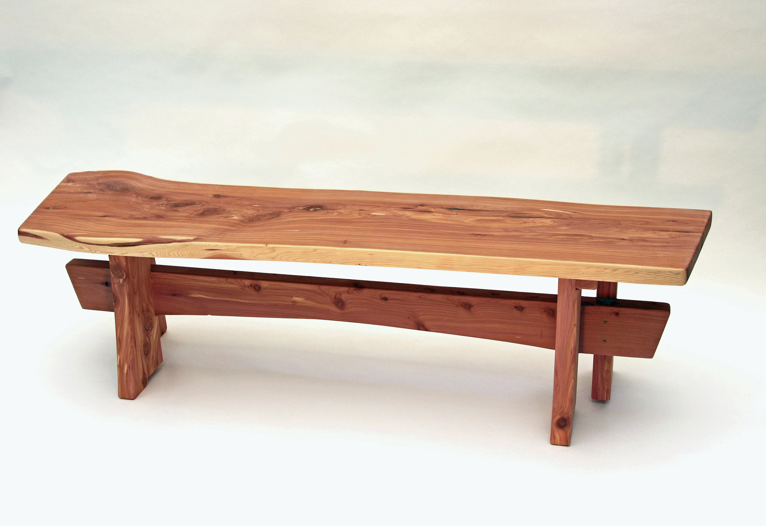 Unfinished Cedar Benches - Left unfinished, the cedar wood ages slowly -- the original reds shifting over time to browns and finally soft grays.