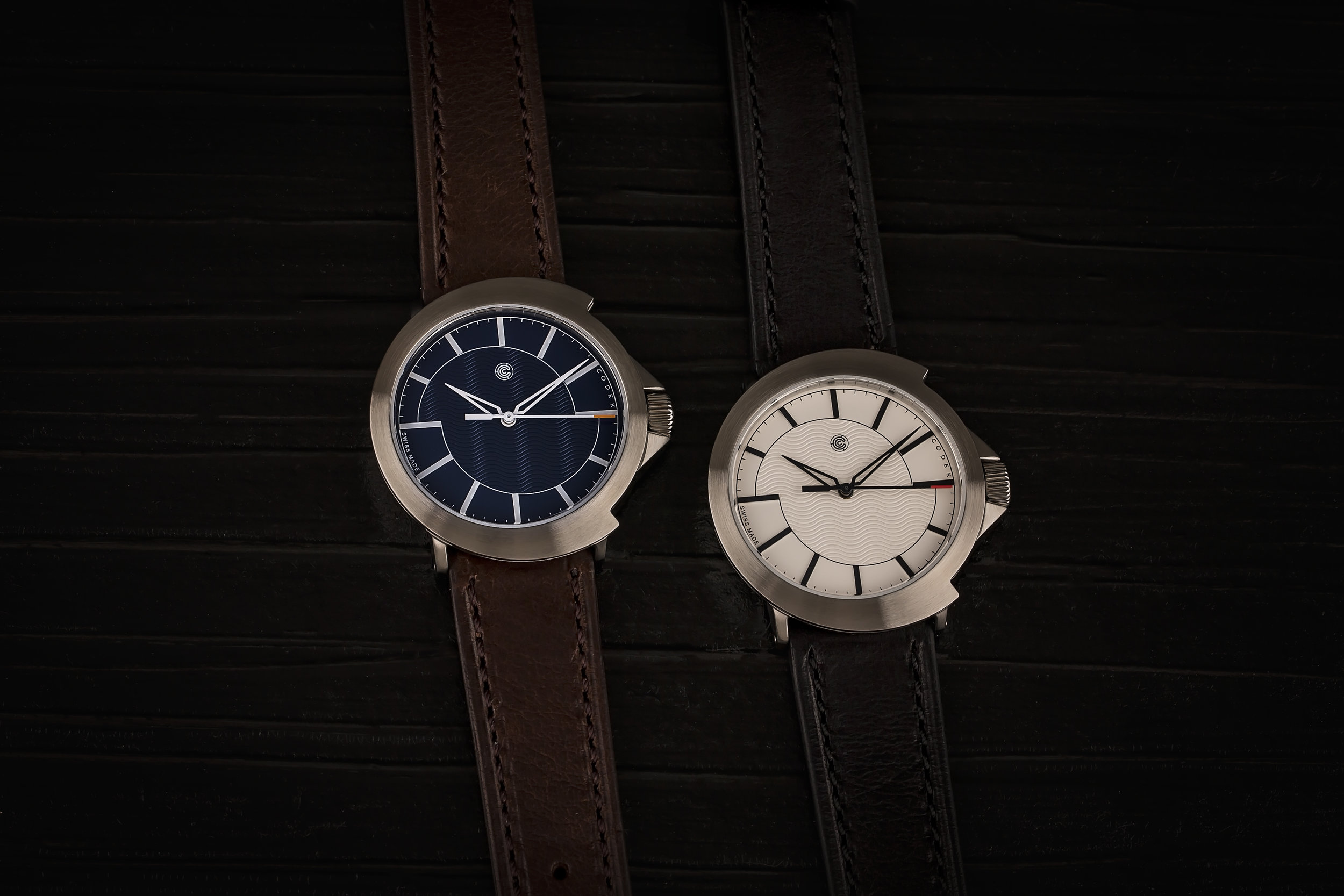 Color Options - There are two dial variants: Midnight Blue with white indices and hands sporting an orange painted tip, and Opaline White with black indices and hands sporting a red painted tip. The contrasting light and dark colors make the watch extremely legible, while the painted tips add a subtle pop of color.