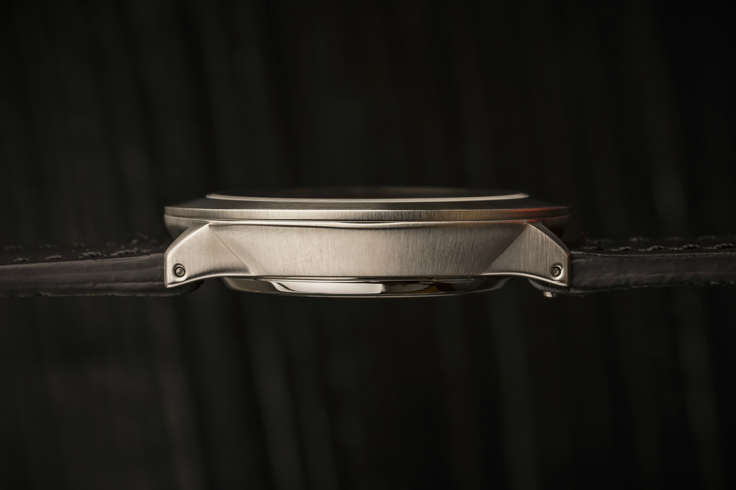 Case - The 316L stainless steel case is beautifully proportioned at 38mm wide (excluding the crown) and 41mm lug-to-lug to look at home on almost any wrist. The non-circular case is complimented by the crown guards and the bowl-shaped profile reduces the caseback surface area for a more comfortable wearing experience.