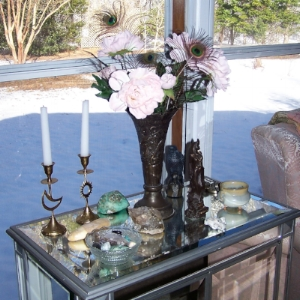 Glamorous and out loud, this all-purpose altar is covered in the owner's personal treasures and is ready for any work she wants to do.