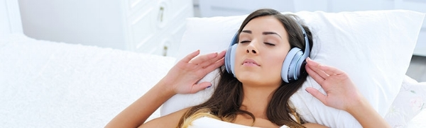 Woman-sleeping-and-looking-relaxed-in-headphones-listening-to-music.jpg