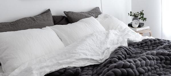 Scandinavian-style-bedroom-with-linen-bedding-Ohhio-chunky-merino-wool-blanket-and-Rainy-Day-print-by-Anu-Tammiste-1.jpg