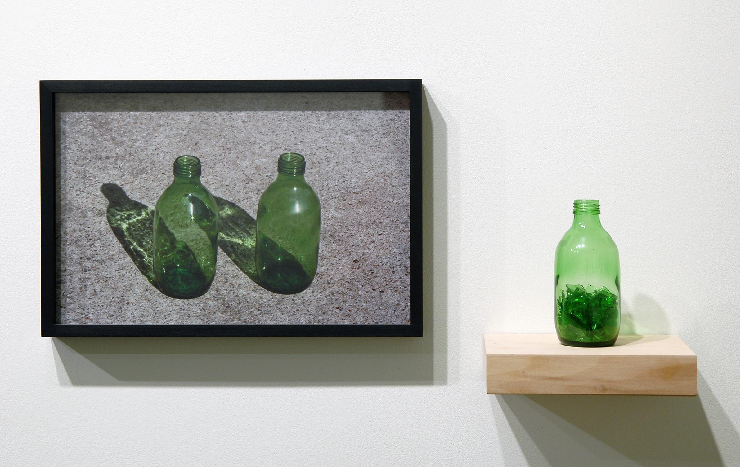 "WITH CINDER BLOCKS WE FLATTEN OUR PHOTOGRAPHS  Pablo Guardiola, Untitled , c-print, glass bottle, broken glass and shelf, 26"" x 12.5"" x 6"", 2013"