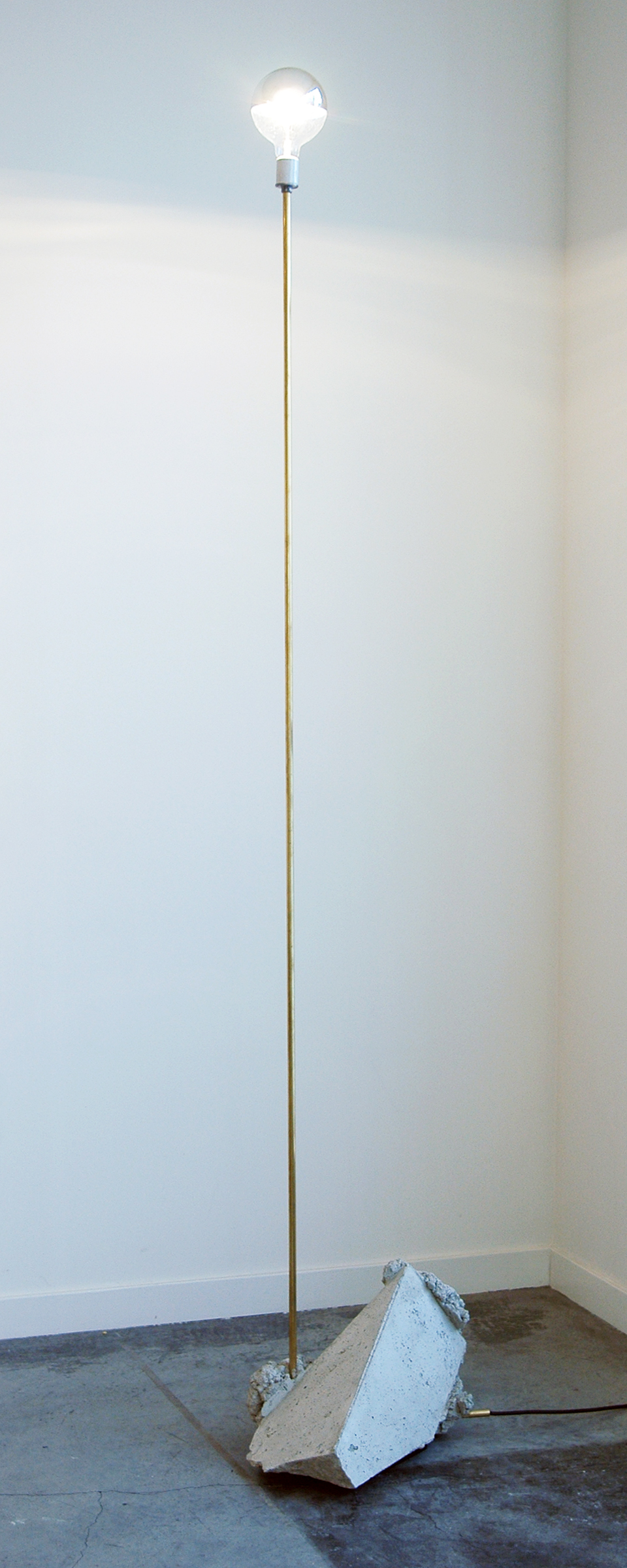 "JONATHAN RUNCIO   Cast-off lamp 02 , brass, concrete, wiring, half crome light bulb, 90"" x 18.5"" x 11"", 2013"