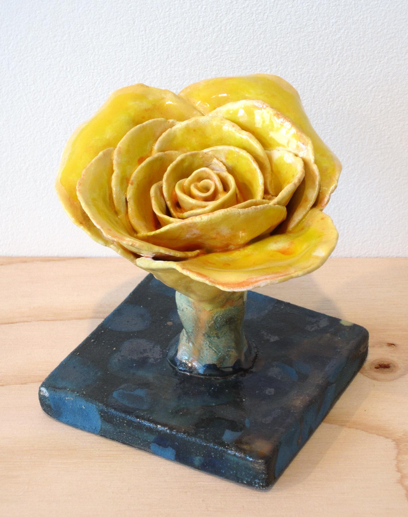 scollon.yellow.flower.tall.jpg