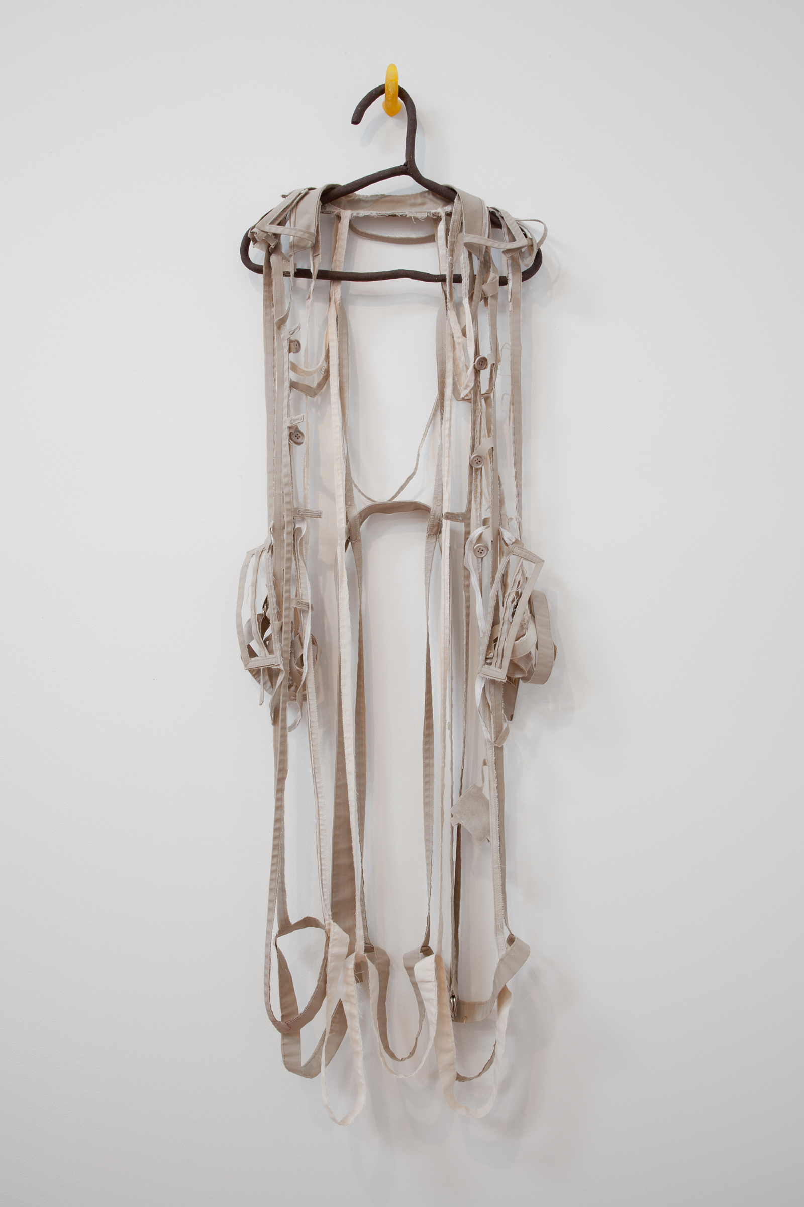 """ANNA SEW HOY   beige/cream , fired stoneware, trench coat and resin finger hook, 55"""" x 17"""" x 3.5"""", 2012"""
