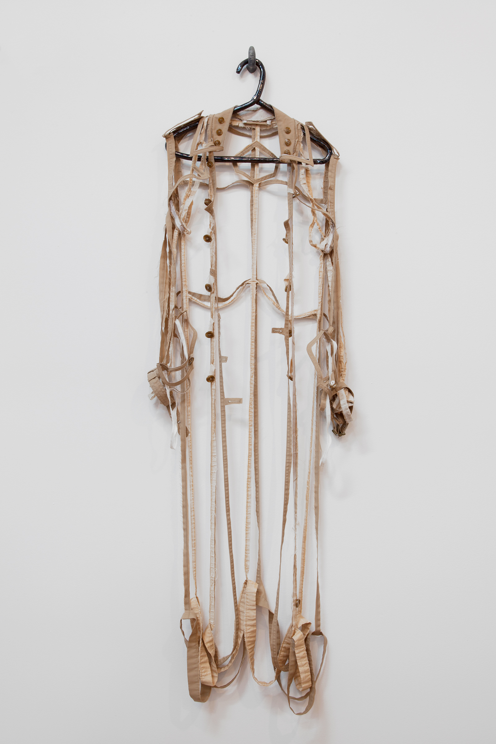 """ANNA SEW HOY   beige/tan , fired stoneware, trench coat and resin finger hook, 62.5"""" x 17"""" x 4"""", 2012"""