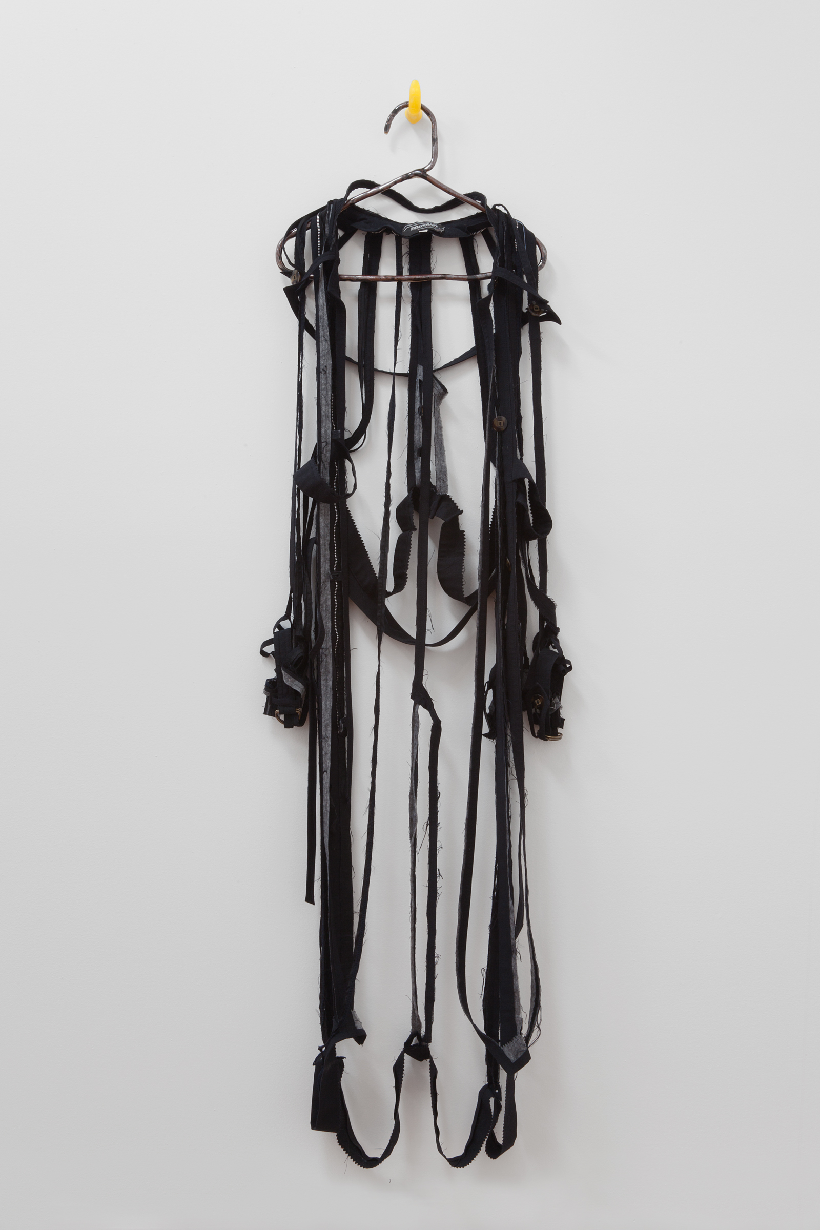 """ANNA SEW HOY   black/noire , fired stoneware, trench coat and resin finger hook, 62.5"""" x 16.5"""" x 4"""", 2012"""