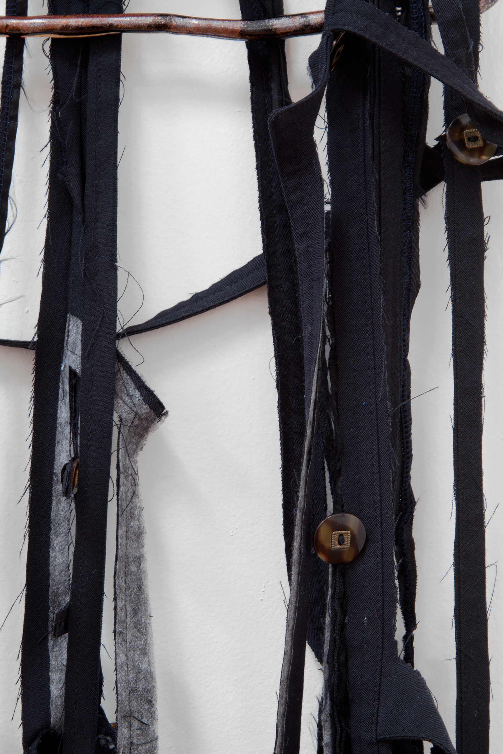 """ANNA SEW HOY  (detail) black/noire , fired stoneware, trench coat and resin finger hook, 62.5"""" x 16.5"""" x 4"""", 2012"""