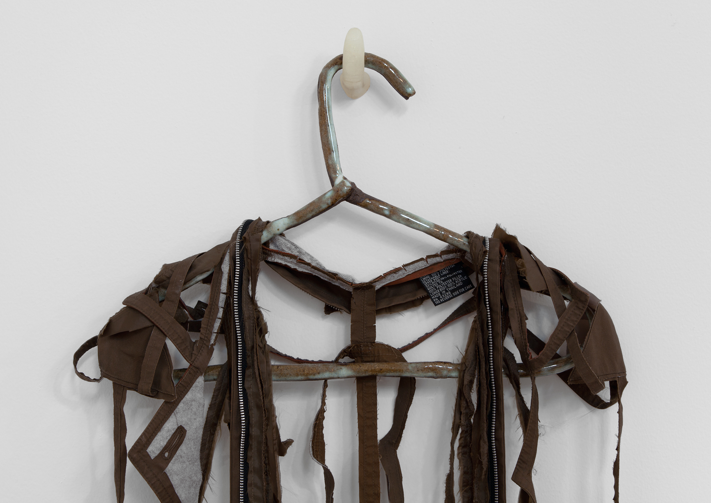 """ANNA SEW HOY  (detail)  chocolate/chocolat , fired stoneware, trench coat and resin finger hook, 58.5"""" x 18"""" x 3.5"""", 2012"""
