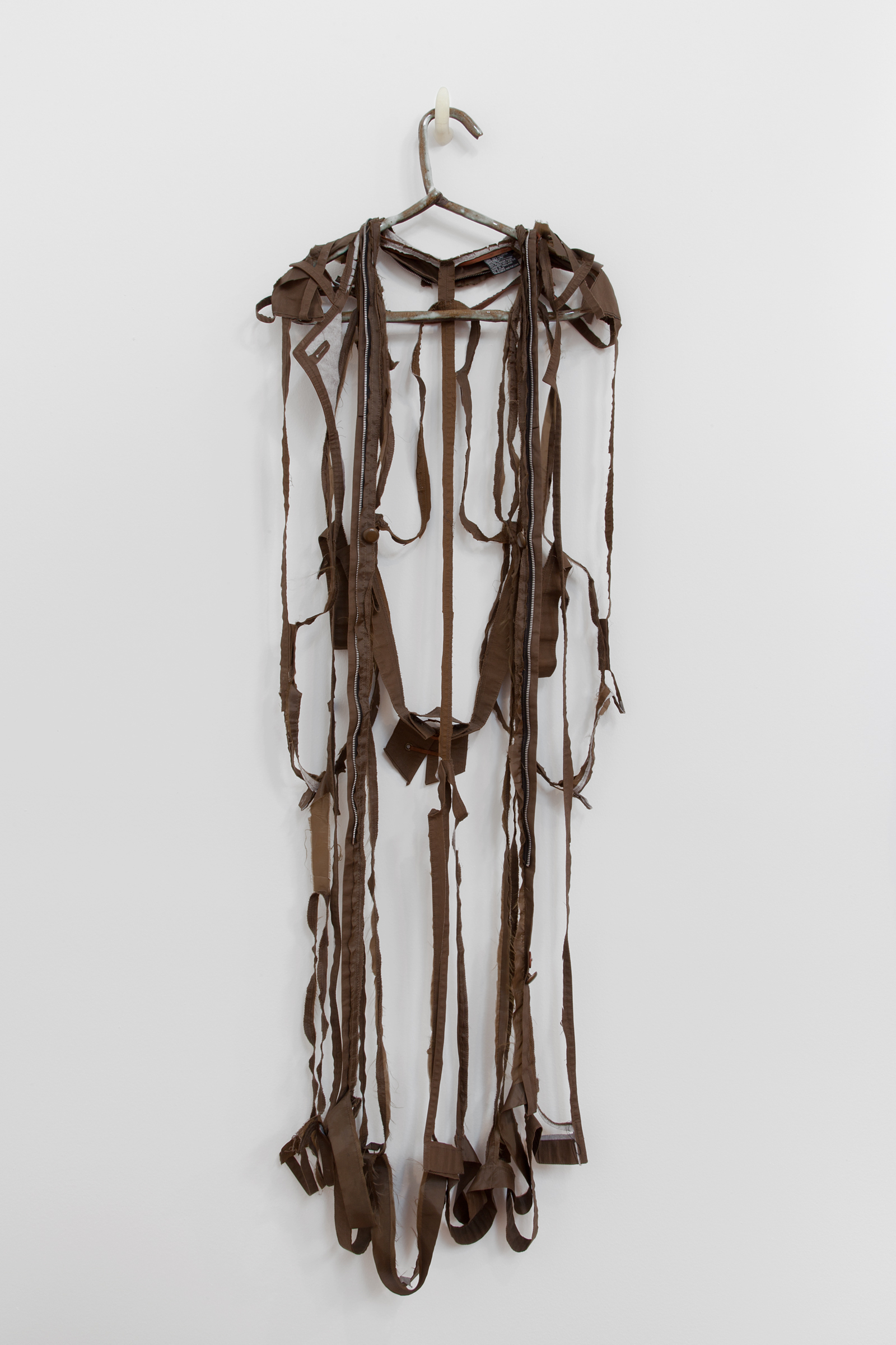 """ANNA SEW HOY   chocolate/chocolat , fired stoneware, trench coat and resin finger hook, 58.5"""" x 18"""" x 3.5"""", 2012"""