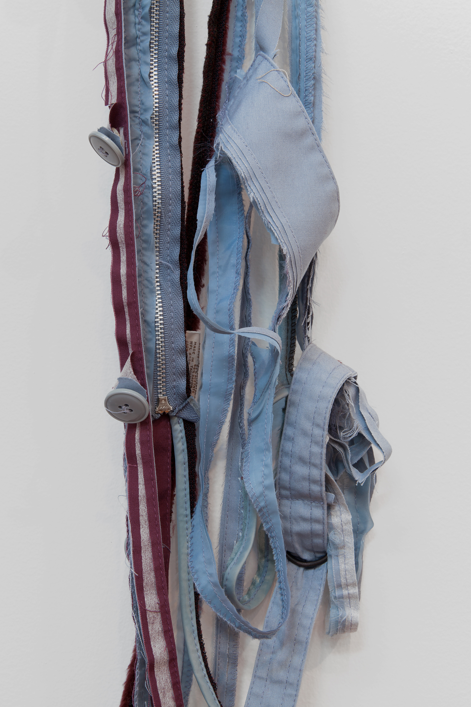 """ANNA SEW HOY  (detail)  maroon/bleu lavande , fired stoneware, trench coat and resin finger hook, 58"""" x 18"""" x 4.5"""", 2012"""