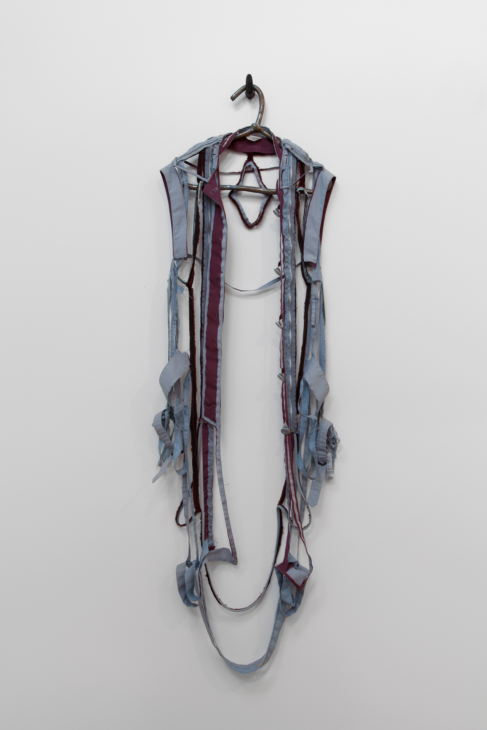 """ANNA SEW HOY   maroon/bleu lavande , fired stoneware, trench coat and resin finger hook, 58"""" x 18"""" x 4.5"""", 2012"""