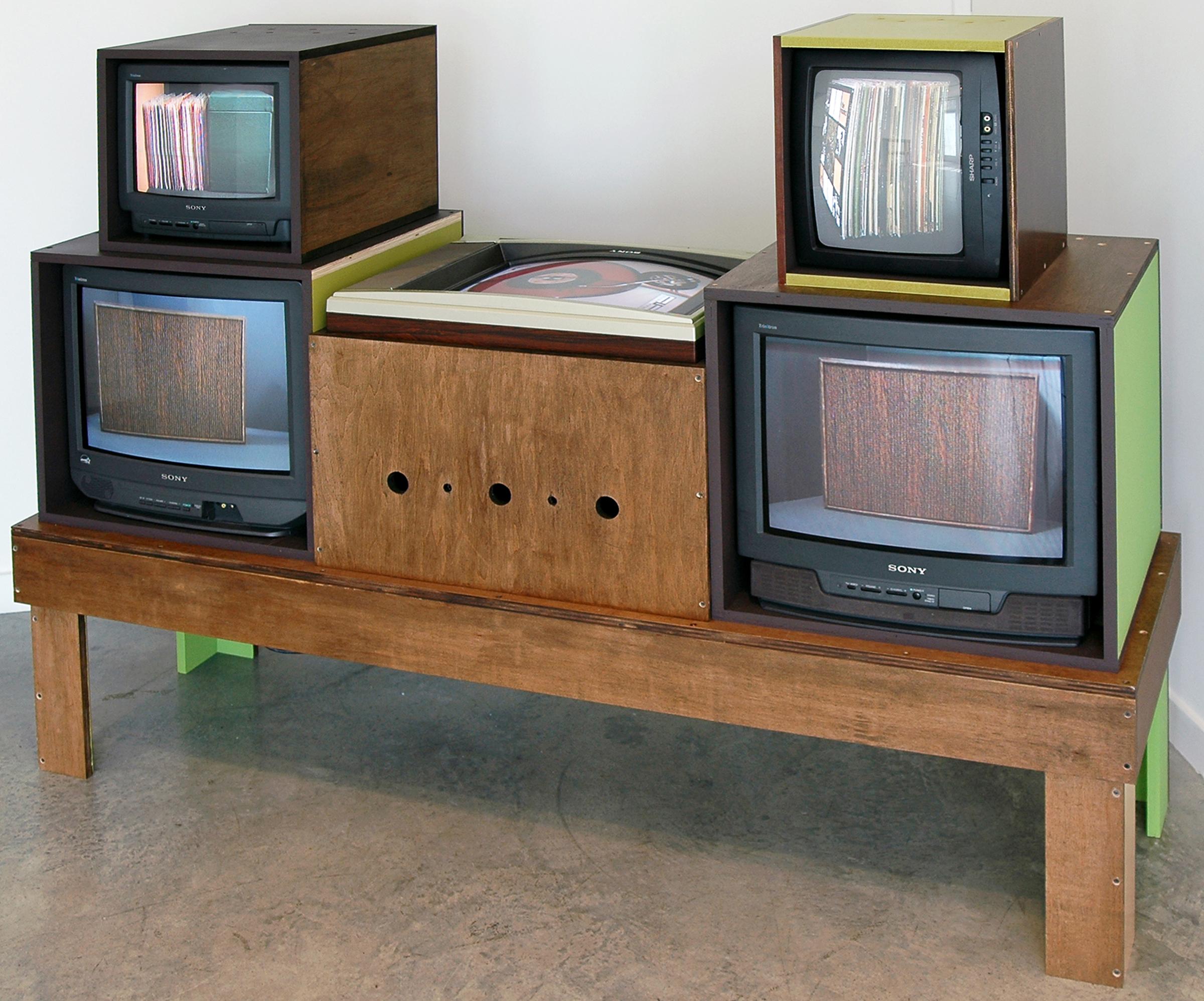 "JOSHUA PIEPER   Video Stereo , CRT monitors, RF modulators, DVD players, plywood and paint, 54"" x 72"" x 22"", 2012"