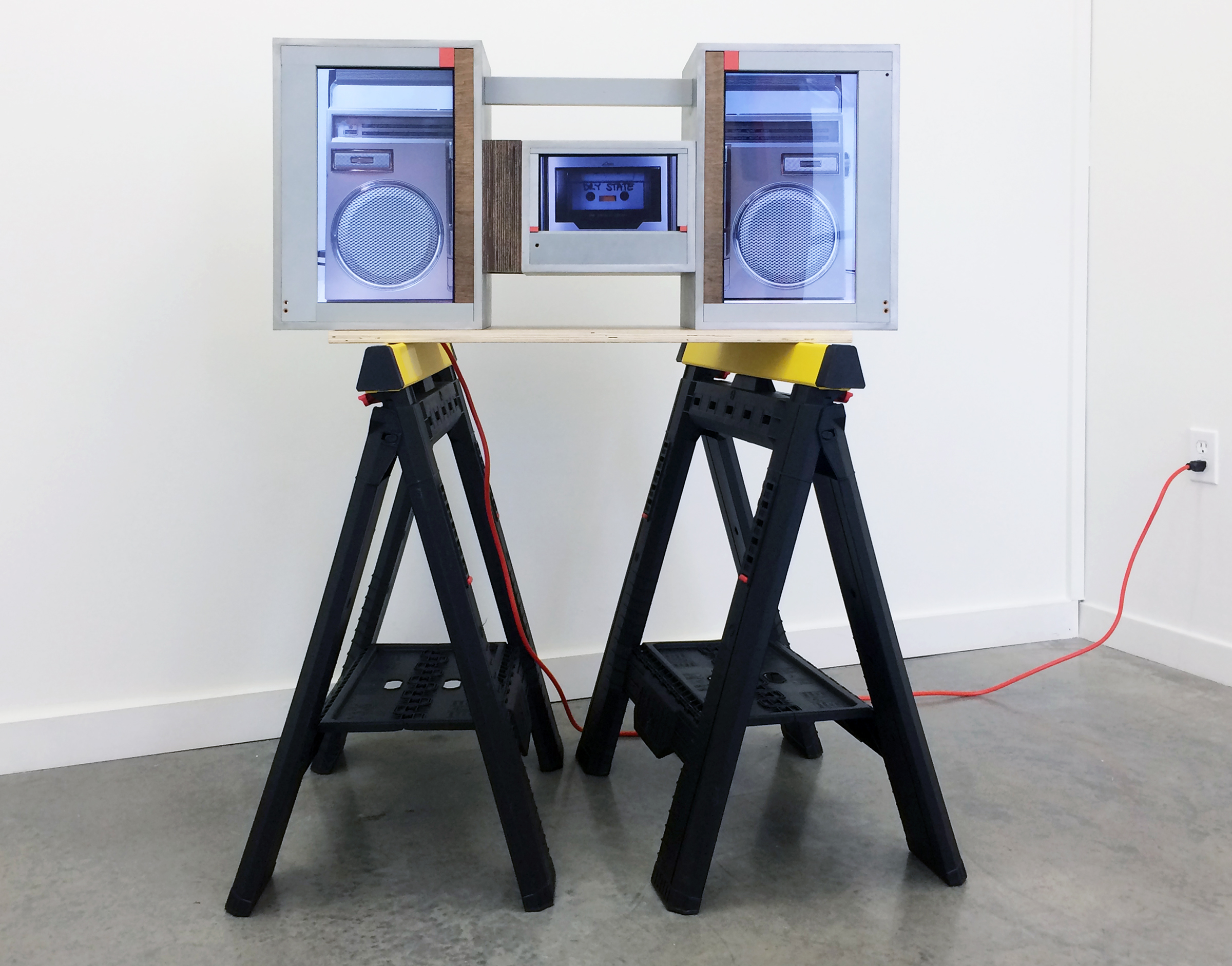 """JOSHUA PIEPER   Video Boom Box , 2015, LCD monitors, dvds, speakers, wood housing and saw horses, 46.75"""" x 35.75"""" x 10"""""""